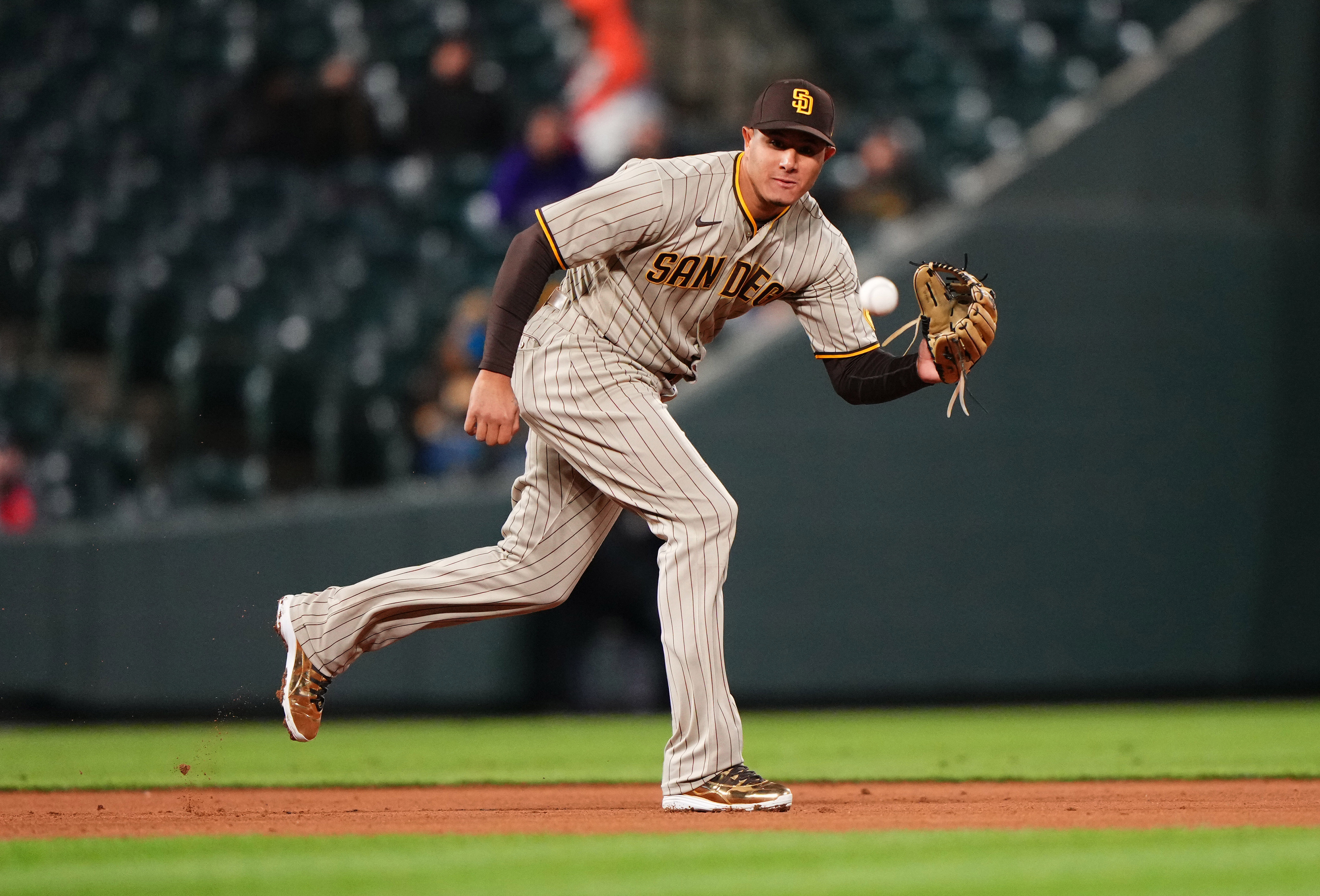 May 11, 2021; Denver, Colorado, USA; San Diego Padres third baseman Manny Machado (13) fields a ball during the ninth inning against the Colorado Rockies at Coors Field. Mandatory Credit: Ron Chenoy-USA TODAY Sports