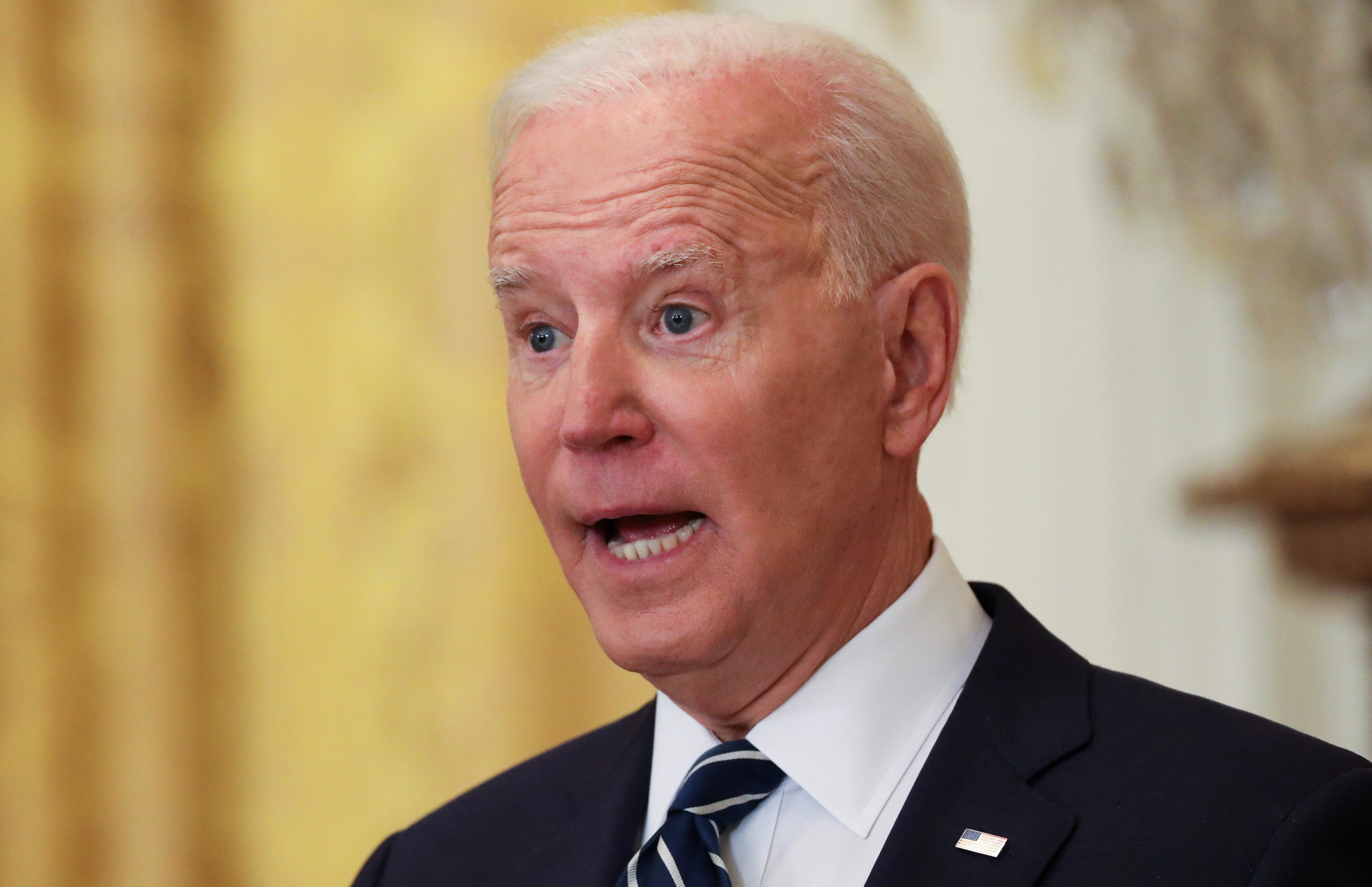 U.S. President Joe Biden answers a question as he holds his first formal news conference as president in the East Room of the White House in Washington, U.S., March 25, 2021. REUTERS/Leah Millis