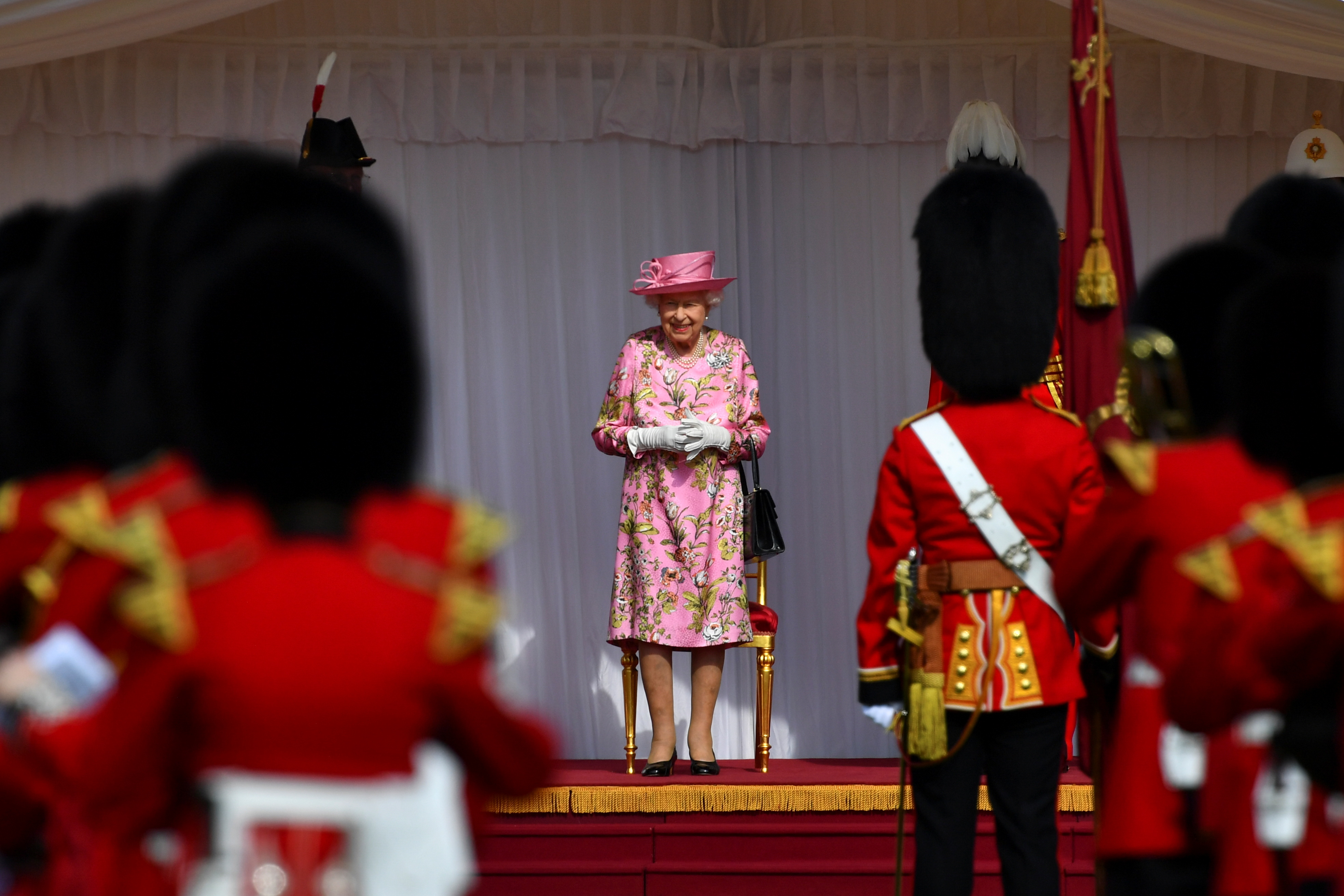 Britain's Queen Elizabeth stands in front of members of the Royal Guard ahead of her meeting with U.S. President Joe Biden and first lady Jill Biden, at Windsor Castle in Windsor, Britain, June 13, 2021. REUTERS/Dylan Martinez