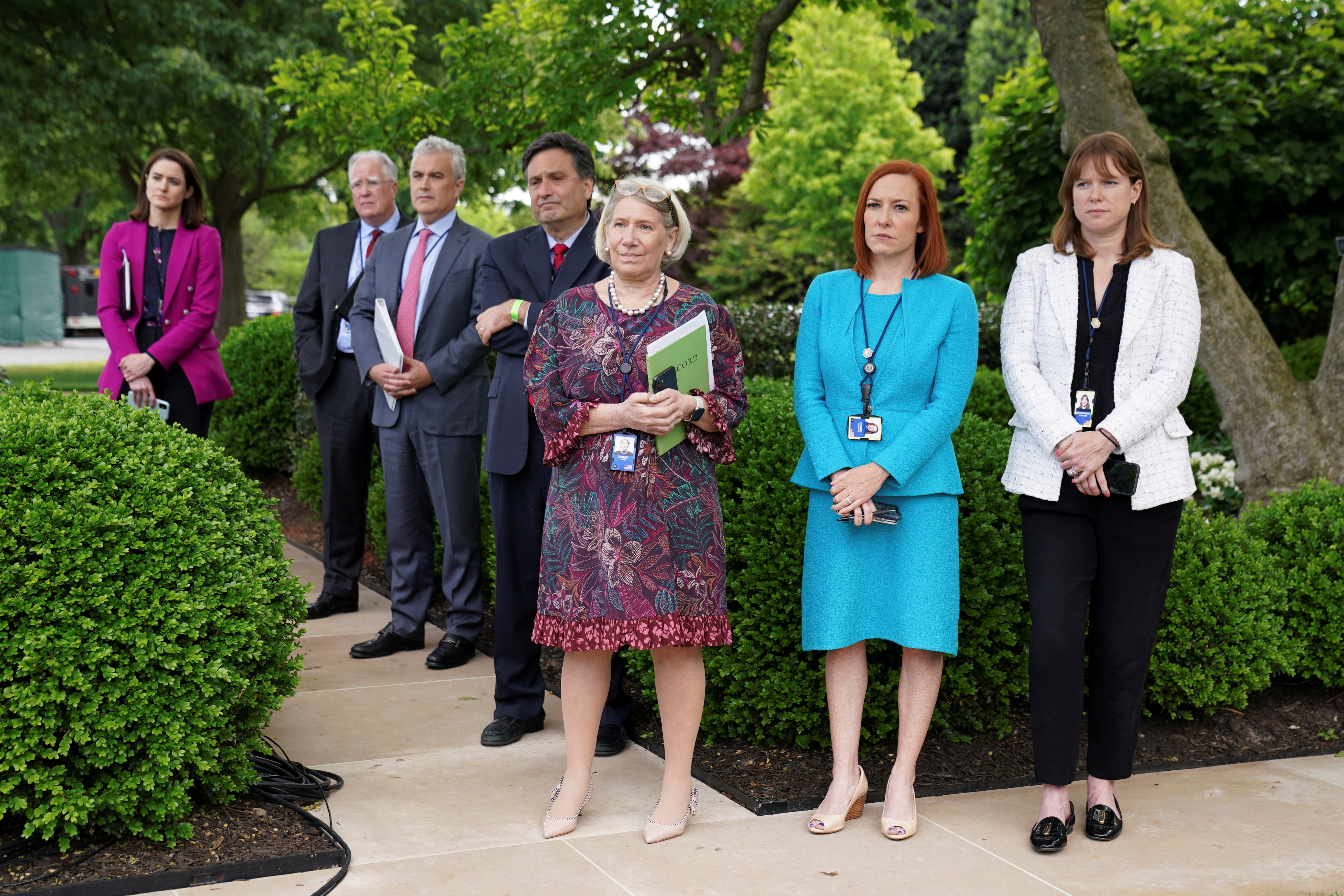 White House Chief of Staff Ron Klain, Senior Advisor to the President Anita Dunn, Press Secretary Jen Psaki, Communications Director Katherine Bedingfield and other staff members stand without protective face masks in the Rose Garden of the White House in Washington, U.S., May 13, 2021. REUTERS/Kevin Lamarque