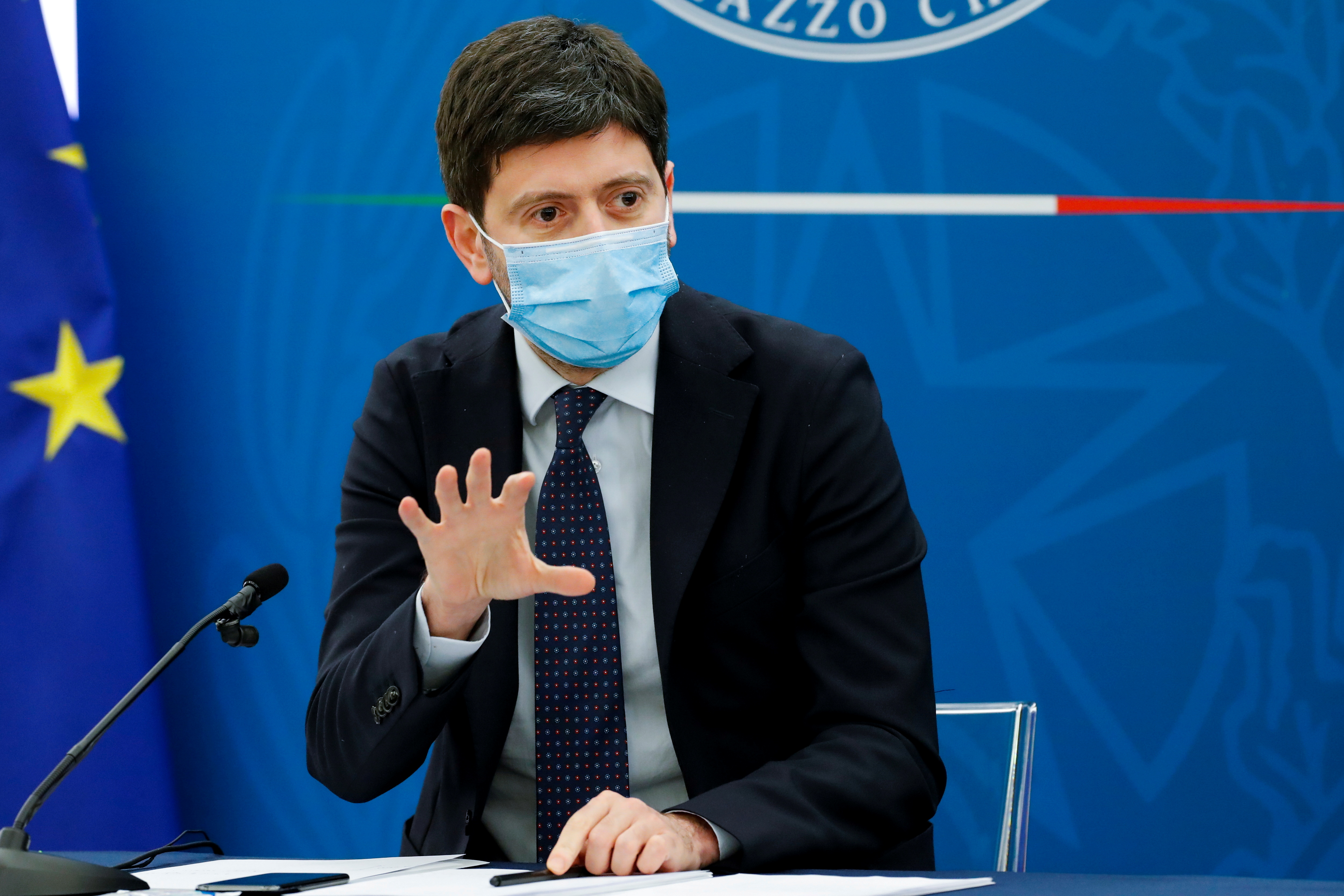 Italy's Health Minister Roberto Speranza gestures as he speaks during a news conference where Italy's Prime Minister Mario Draghi (not pictured) is expected to map out the country's next moves in loosening coronavirus disease (COVID-19) restrictions, in Rome, Italy, April 16, 2021. REUTERS/Remo Casilli/Pool/File Photo