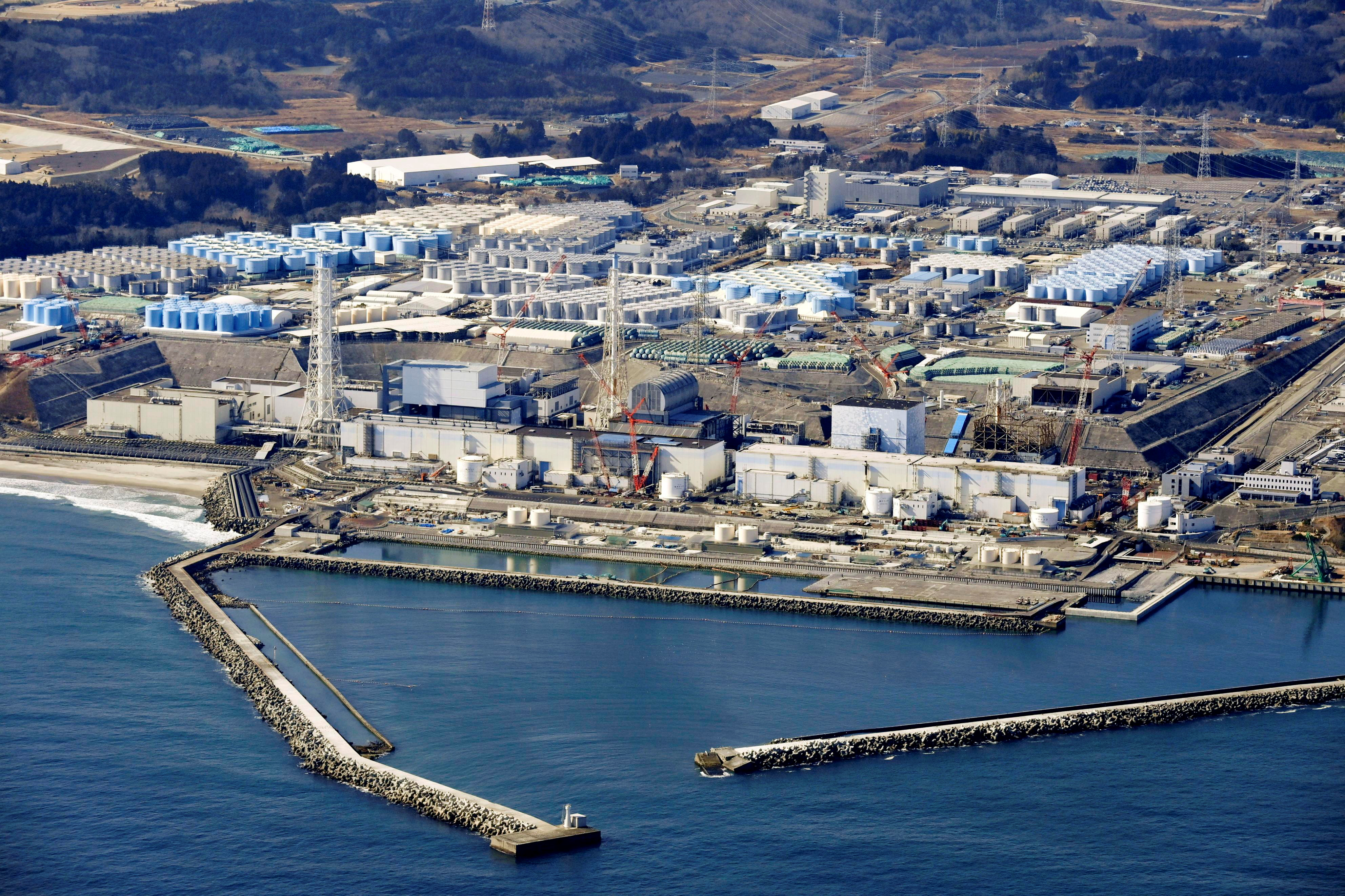 An aerial view shows the storage tanks for treated water at the tsunami-crippled Fukushima Daiichi nuclear power plant in Okuma town, Fukushima prefecture, Japan February 13, 2021, in this photo taken by Kyodo.  Kyodo/via REUTERS