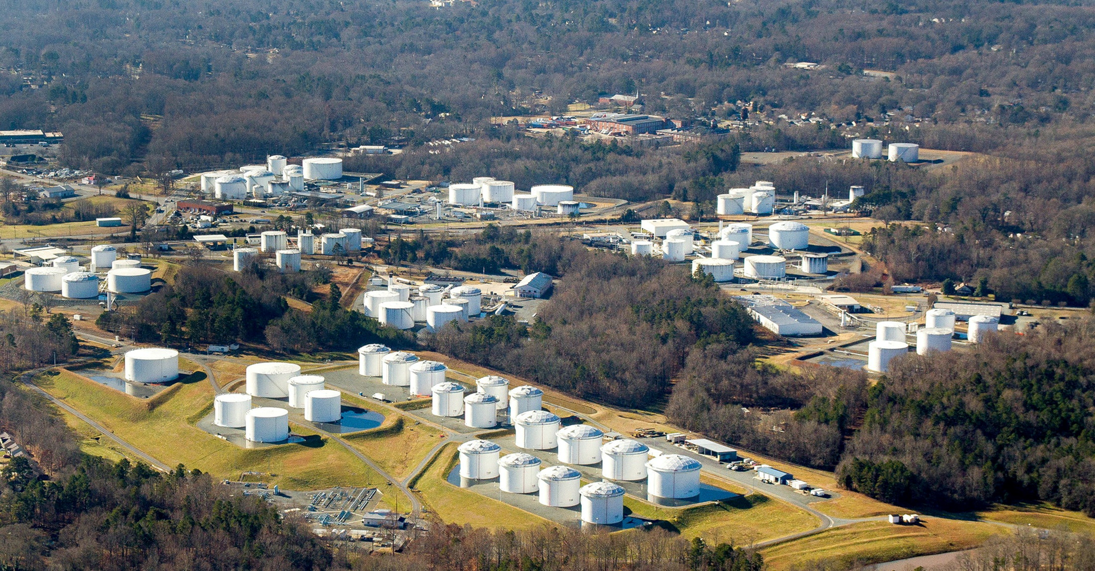 Holding tanks are seen at Colonial Pipeline's Charlotte Tank Farm in Charlotte, North Carolina, U.S. an undated photograph.  Colonial Pipeline/Handout via REUTERS