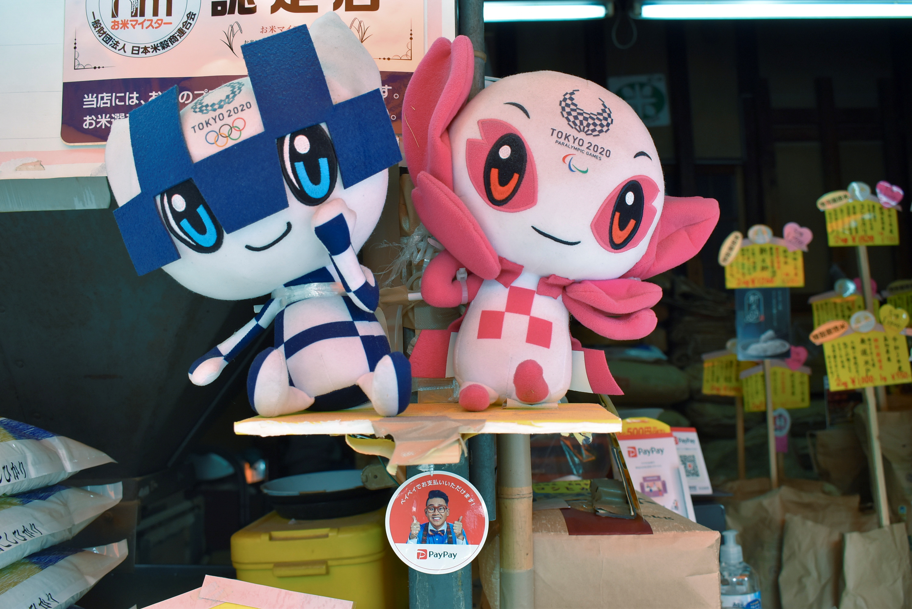 Tokyo 2020 mascots and a PayPay app sticker are displayed at the rice dealer's shop Mikawaya, in Tokyo, Japan June 7, 2021. Picture taken June 7, 2021. REUTERS/Sam Nussey