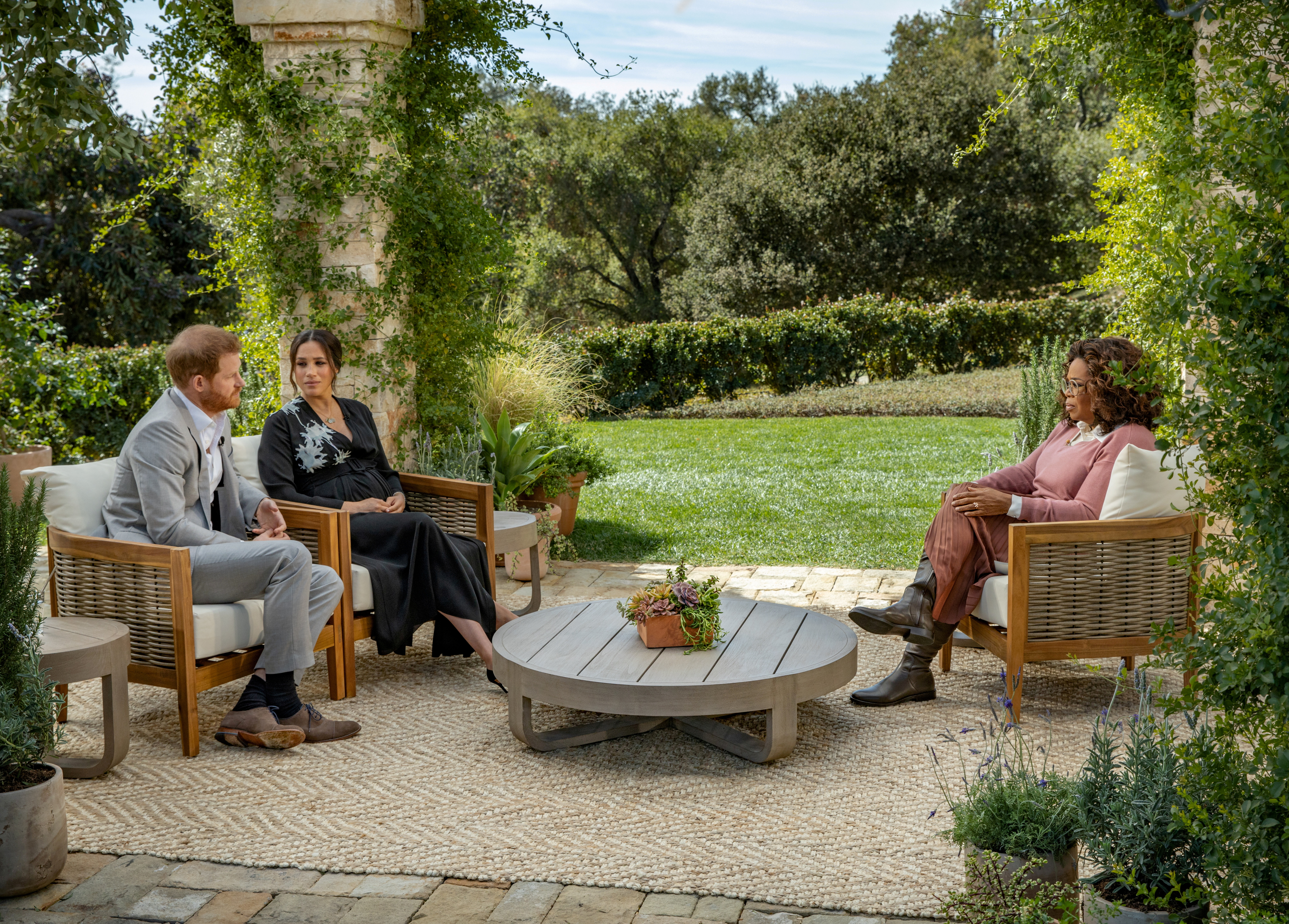 Britain's Prince Harry and Meghan, Duchess of Sussex, are interviewed by Oprah Winfrey in this undated handout photo.  Harpo Productions/Joe Pugliese/Handout via REUTERS/File Photo