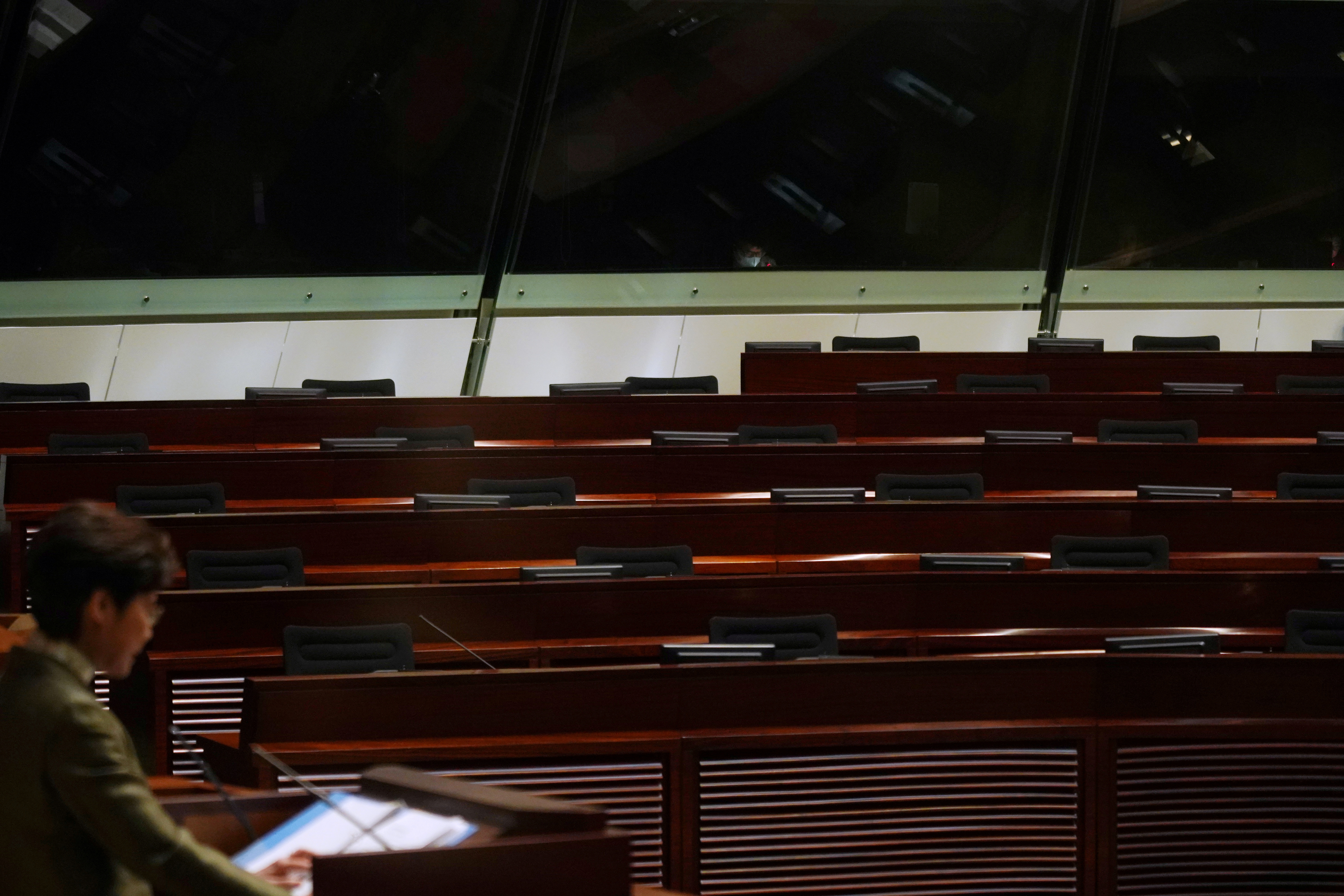 Empty seats of pro-democracy lawmakers are seen during Hong Kong Chief Executive Carrie Lam's annual policy address at the Legislative Council in Hong Kong, China November 25, 2020. REUTERS/Lam Yik/File Photo