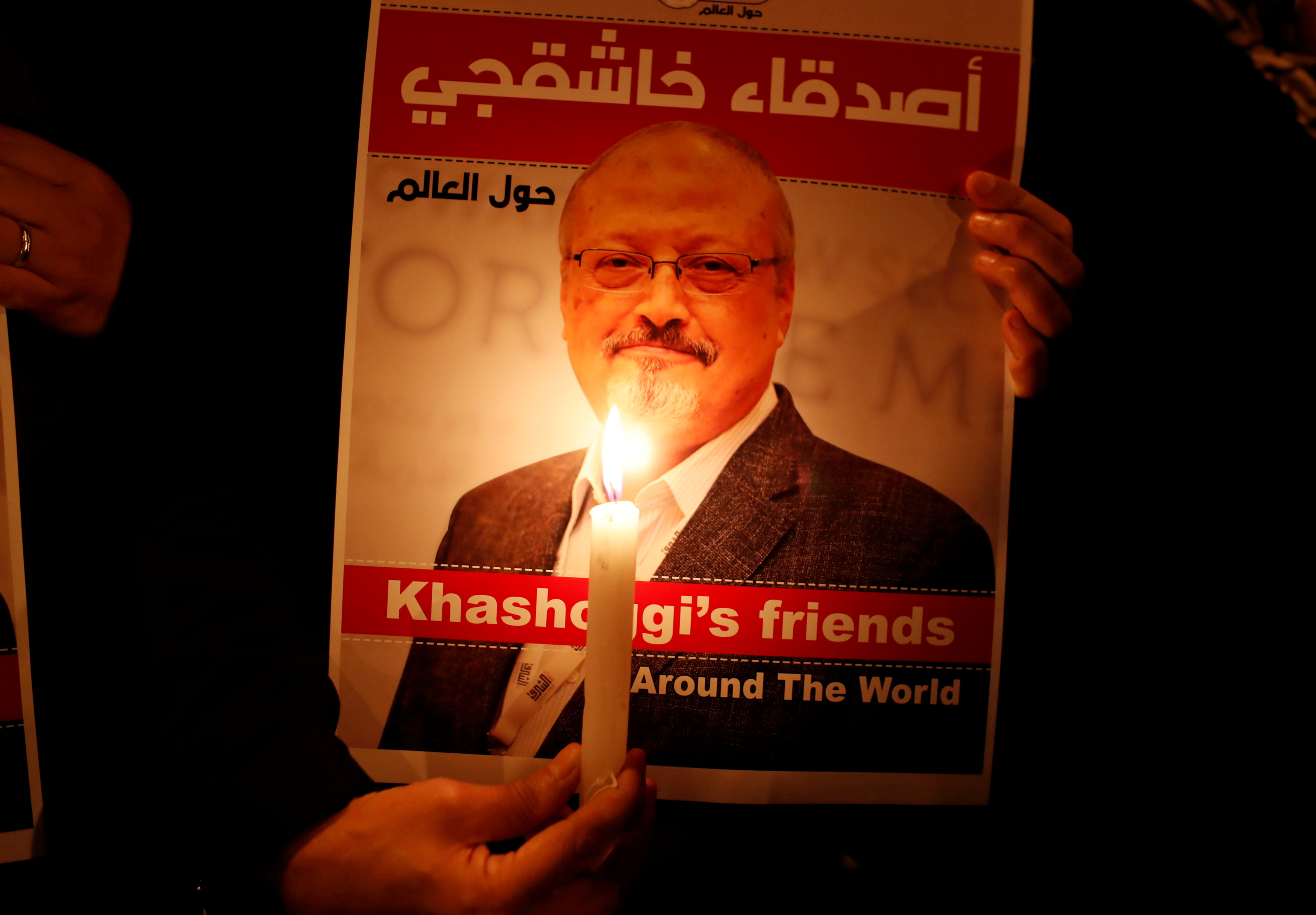 A demonstrator holds a poster with a picture of Saudi journalist Jamal Khashoggi outside the Saudi Arabia consulate in Istanbul, Turkey October 25, 2018. REUTERS/Osman Orsal/File Photo