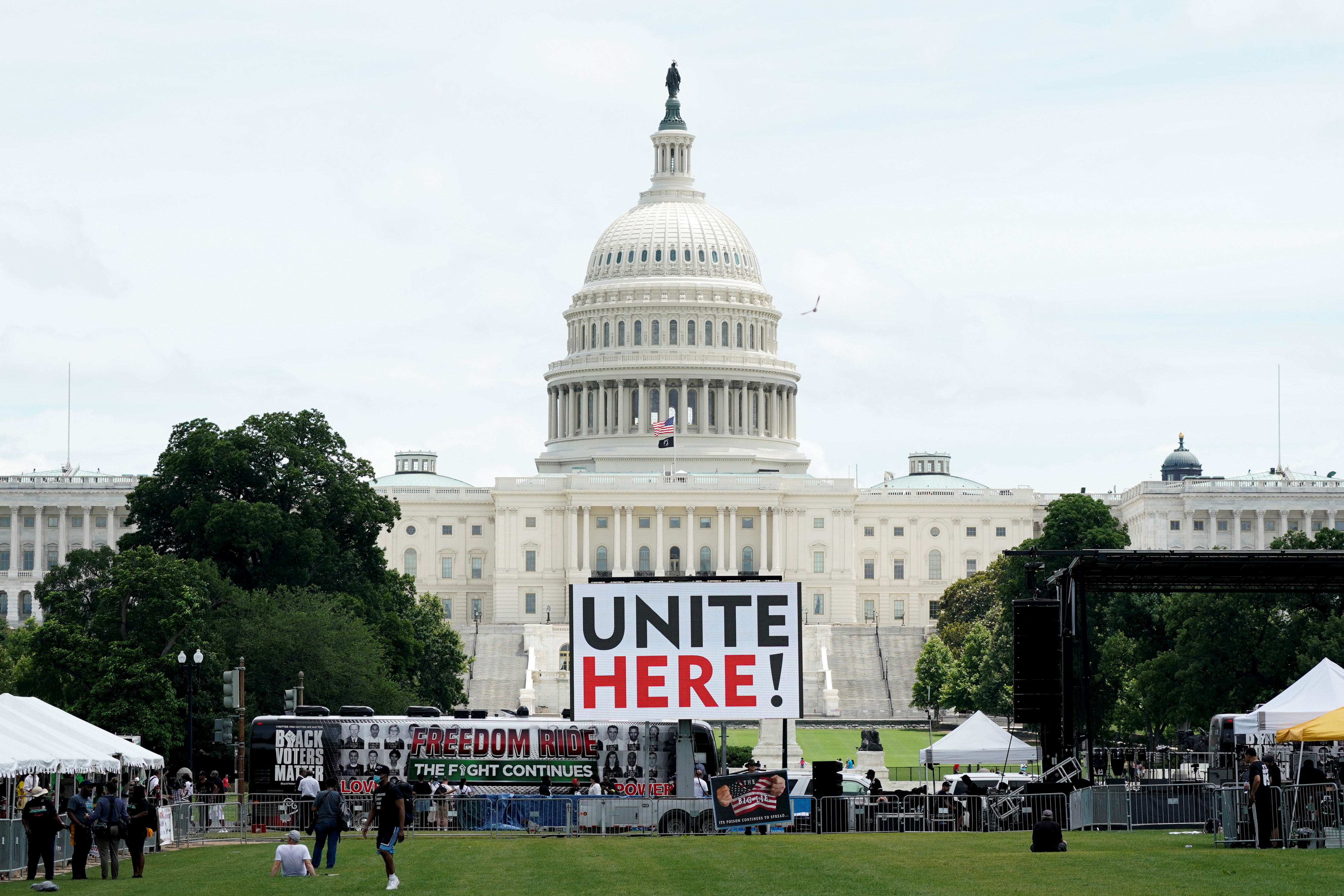 A Freedom Ride for Voting Rights 2021 bus is seen in front of the U.S. Capitol building before the start of a rally in support of District of Columbia (DC) statehood and voting rights on the National Mall in Washington, DC, U.S. June 26, 2021.  REUTERS/Elizabeth Frantz