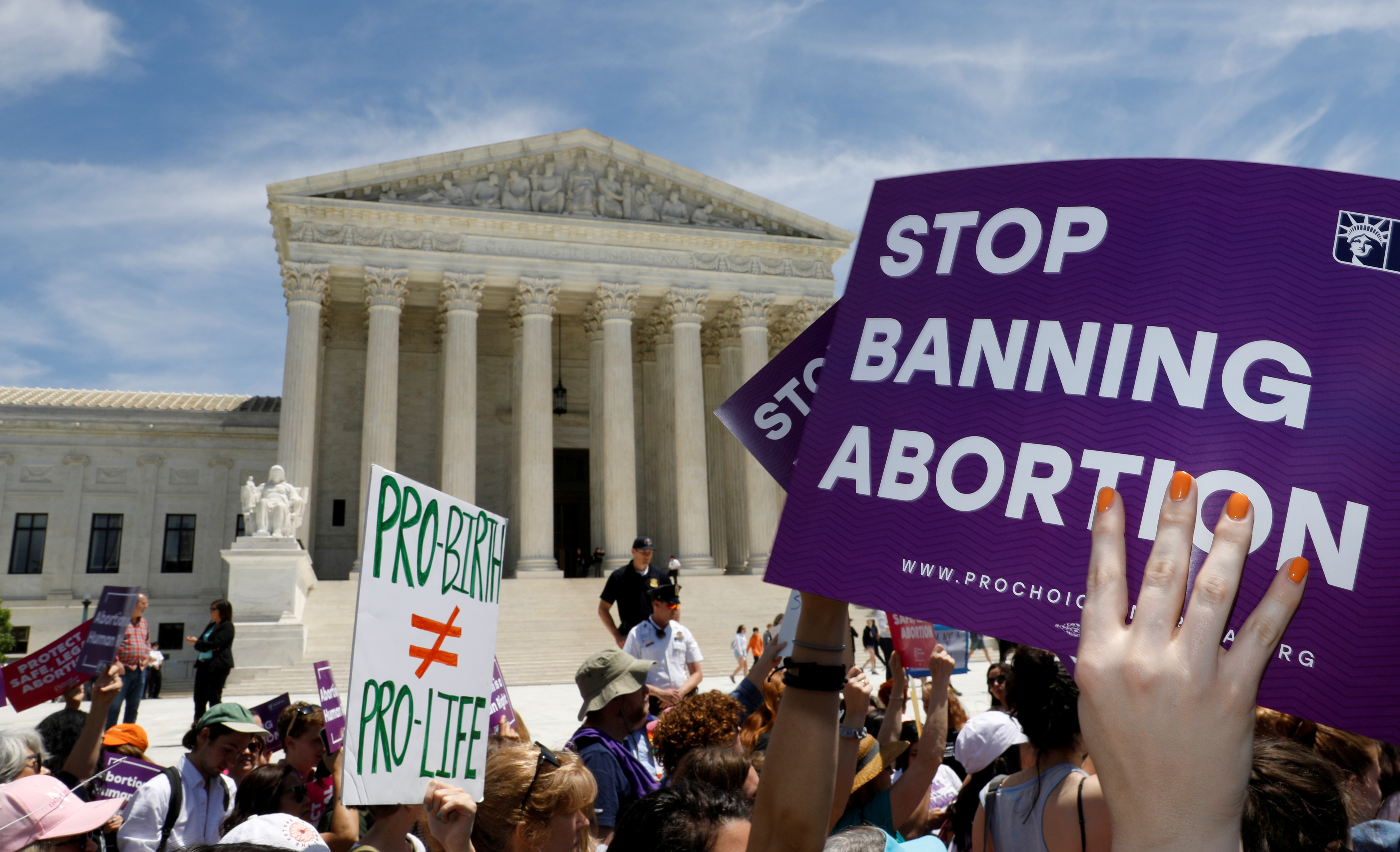 File photo: Abortion rights activists rally outside the U.S. Supreme Court in Washington, U.S., May 21, 2019. REUTERS/Kevin Lamarque.