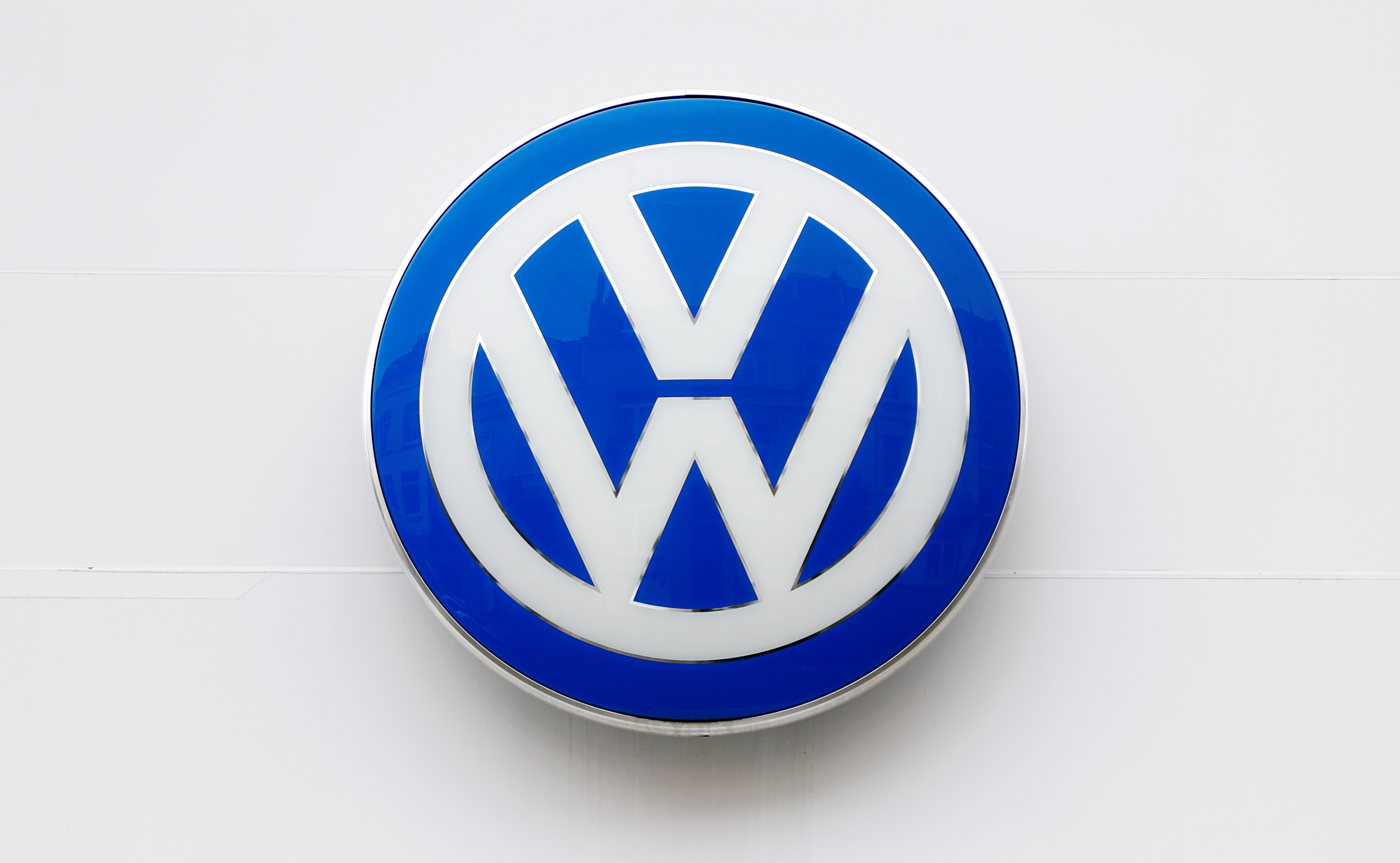 The logo of German carmaker Volkswagen is seen on the wall of a showroom of a Volkswagen car dealer in Brussels, Belgium July 9, 2020. REUTERS/Francois Lenoir/File Photo
