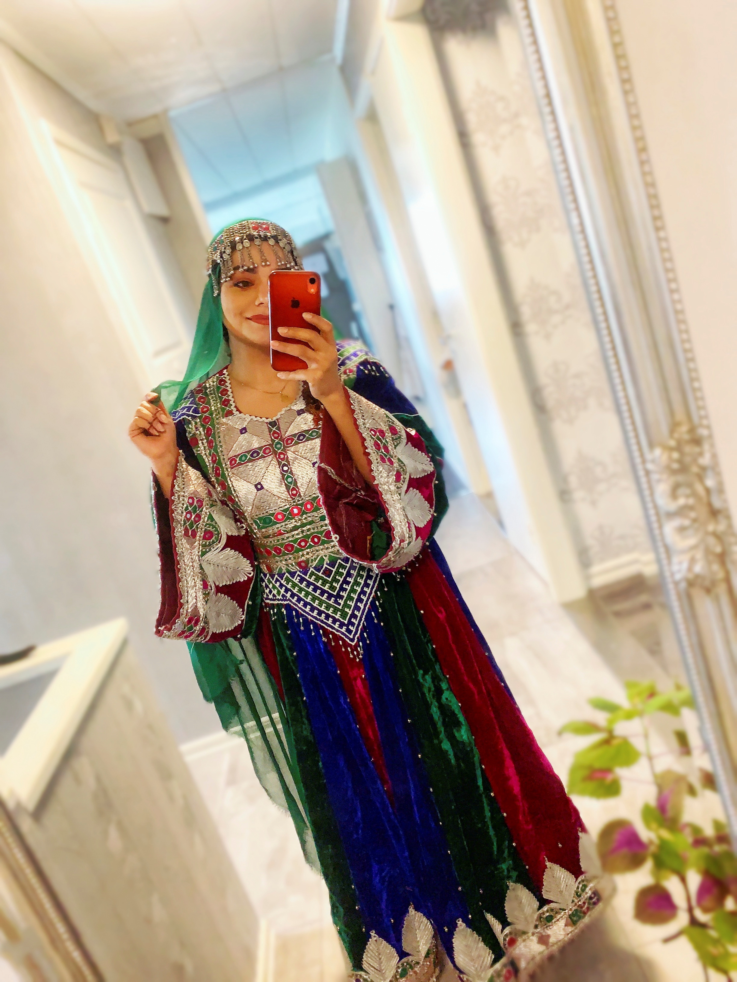 A woman poses in traditional Afghan attire, in Stockholm, Sweden, March 21, 2021, in this picture obtained from social media. Wazhma Sayle/via REUTERS   THIS IMAGE HAS BEEN SUPPLIED BY A THIRD PARTY. MANDATORY CREDIT. NO RESALES. NO ARCHIVES.