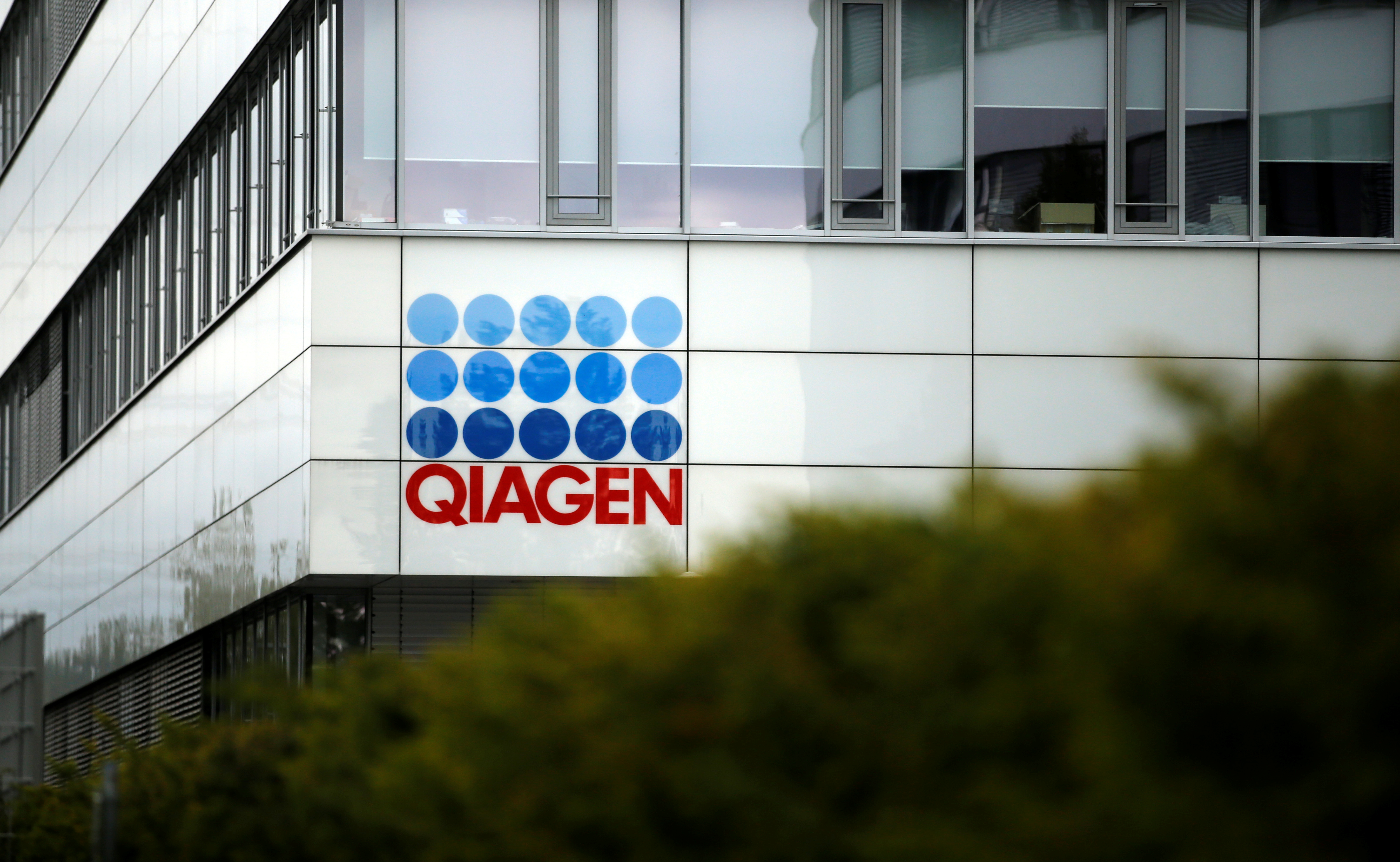 A logo of a testing company Qiagen is seen at Qiagen's facility, in Hilden, Germany, September 8, 2020. REUTERS/Leon Kuegeler