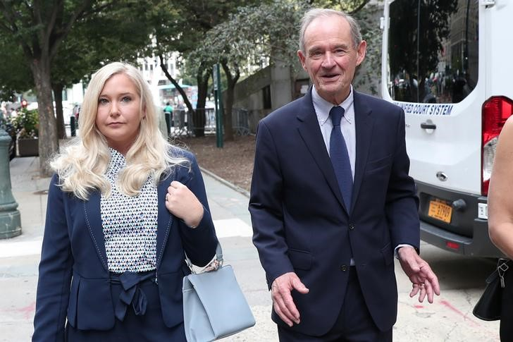Lawyer David Boies arrives with his client Virginia Giuffre. REUTERS/Shannon Stapleton