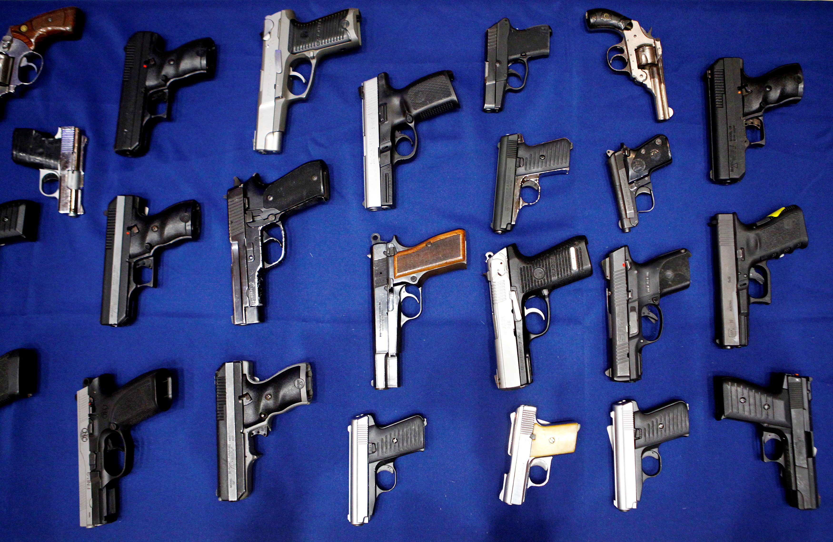 Seized handguns are pictured at the police headquarters in New York, August 19, 2013. REUTERS/Eric Thayer
