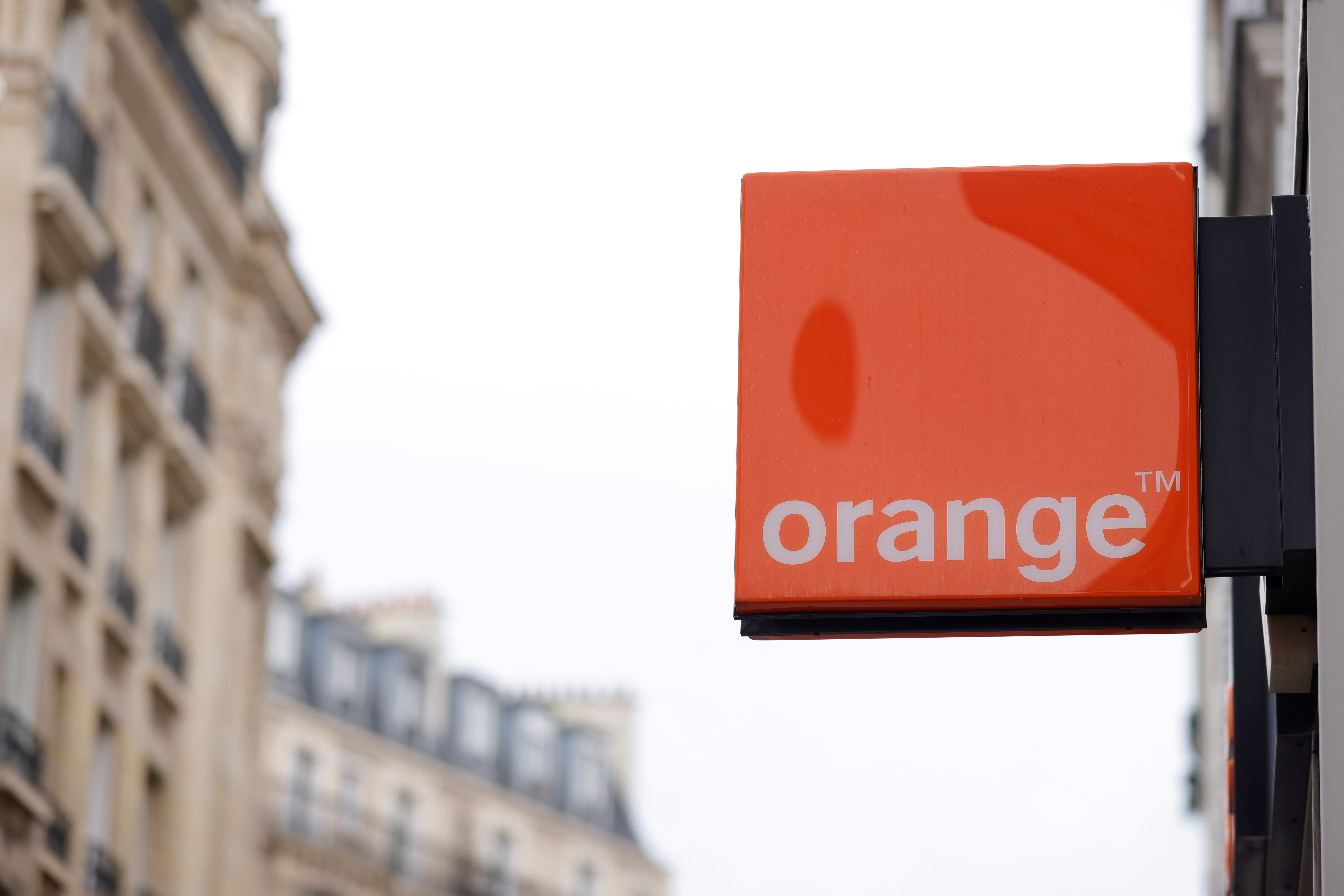 The logo of French telecoms operator Orange is seen on the facade of a store in Paris, France, February 16, 2021. REUTERS/Sarah Meyssonnier