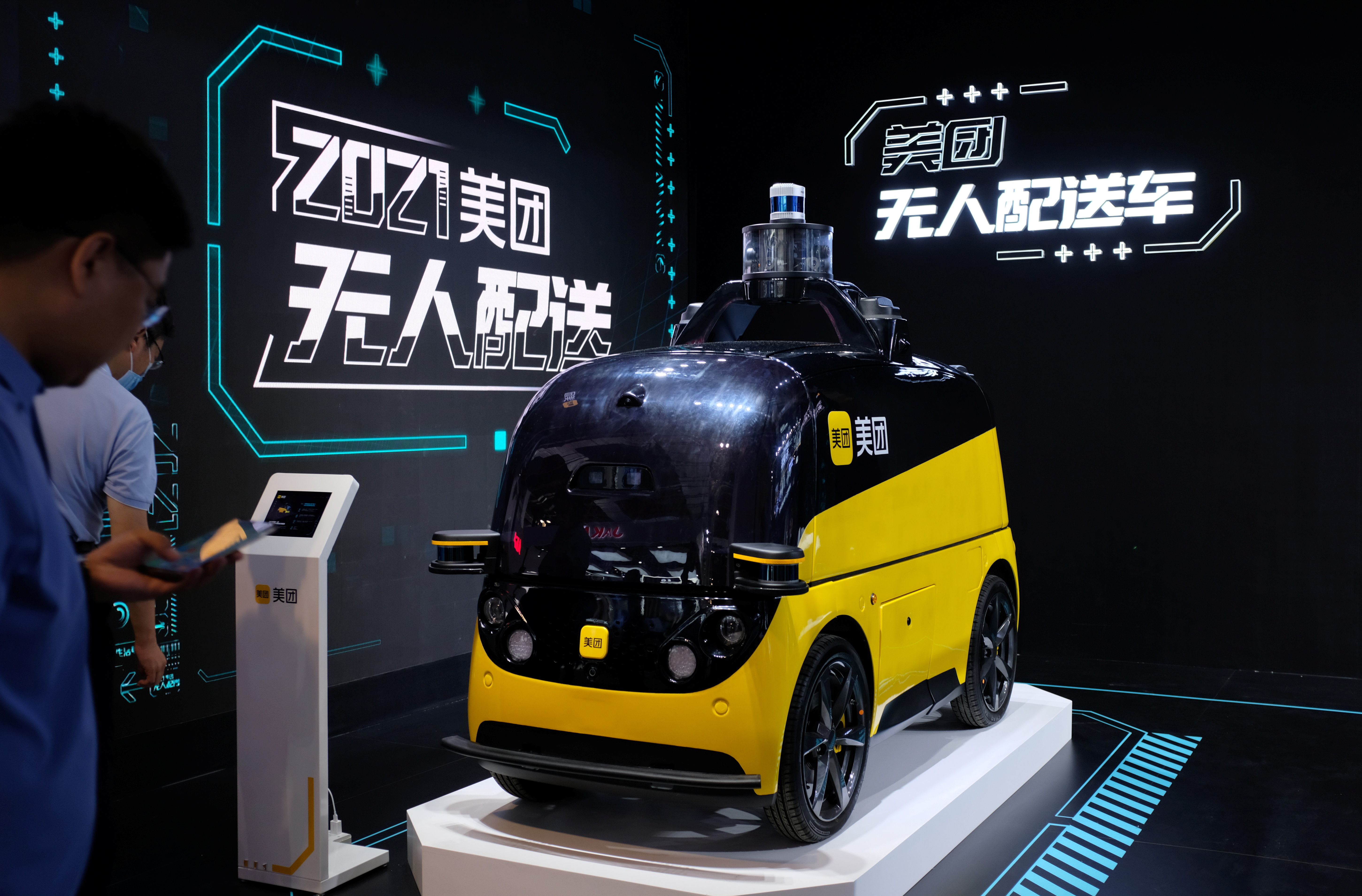 An autonomous delivery vehicle by Meituan is displayed at the World Artificial Intelligence Conference (WAIC) in Shanghai, China July 8, 2021. REUTERS/Yilei Sun