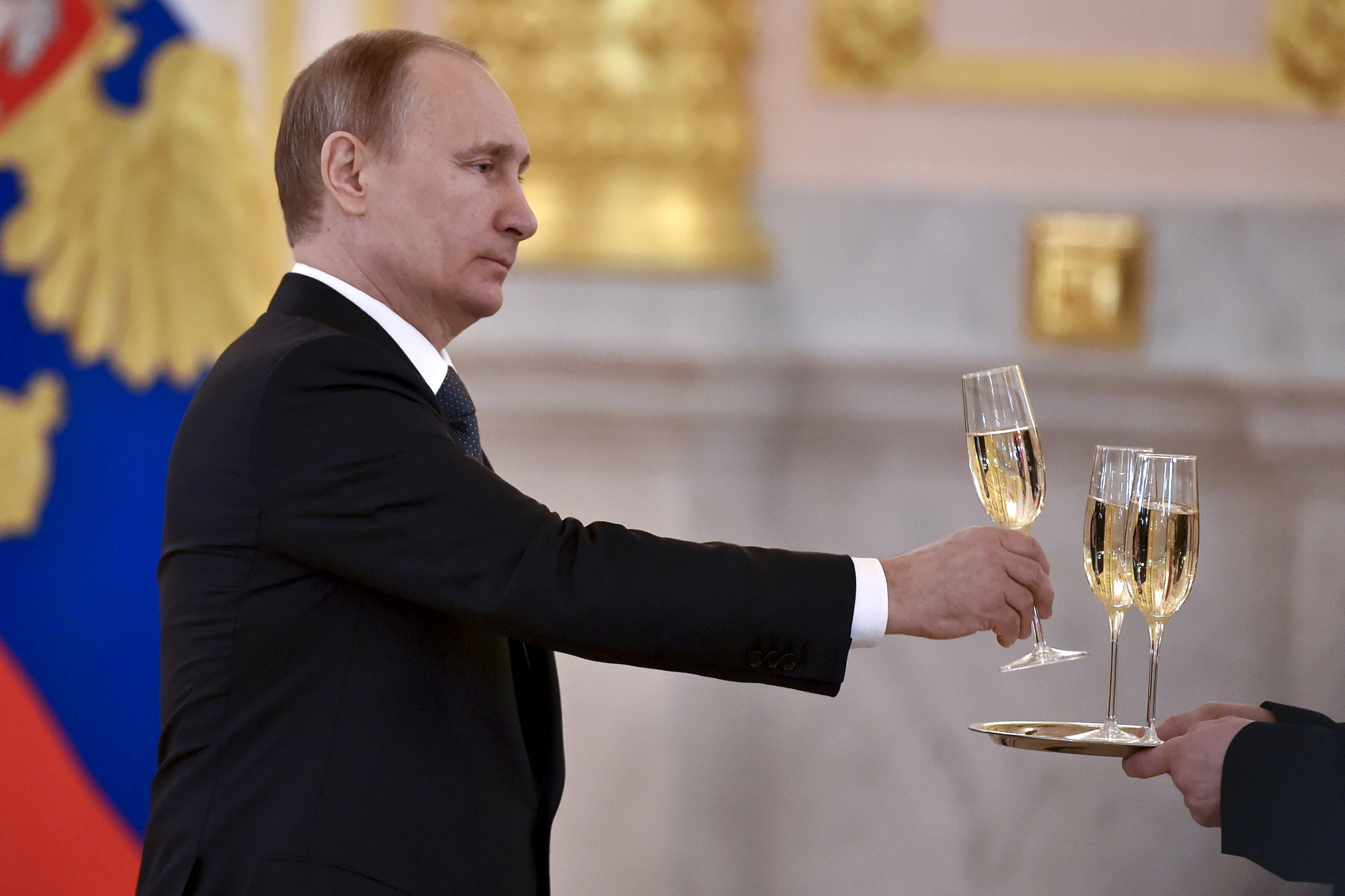 Russia's President Vladimir Putin holds a glass as he attends a ceremony to receive credentials from foreign ambassadors at the Kremlin in Moscow, Russia, April 20, 2016. REUTERS/Kirill Kudryavtsev/Pool/File Photo