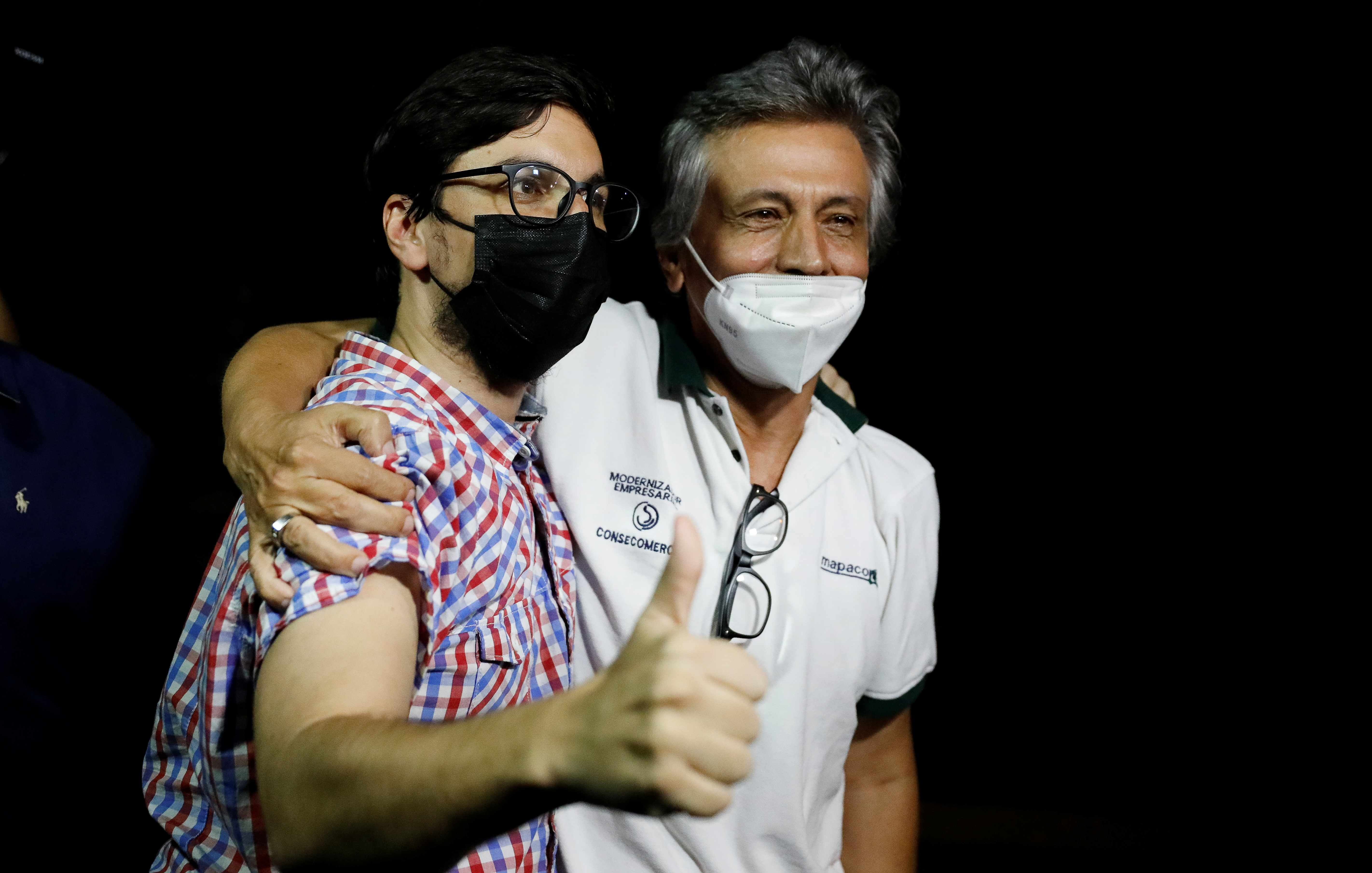Venezuelan opposition leader Freddy Guevara gestures as he hugs his father after leaving
