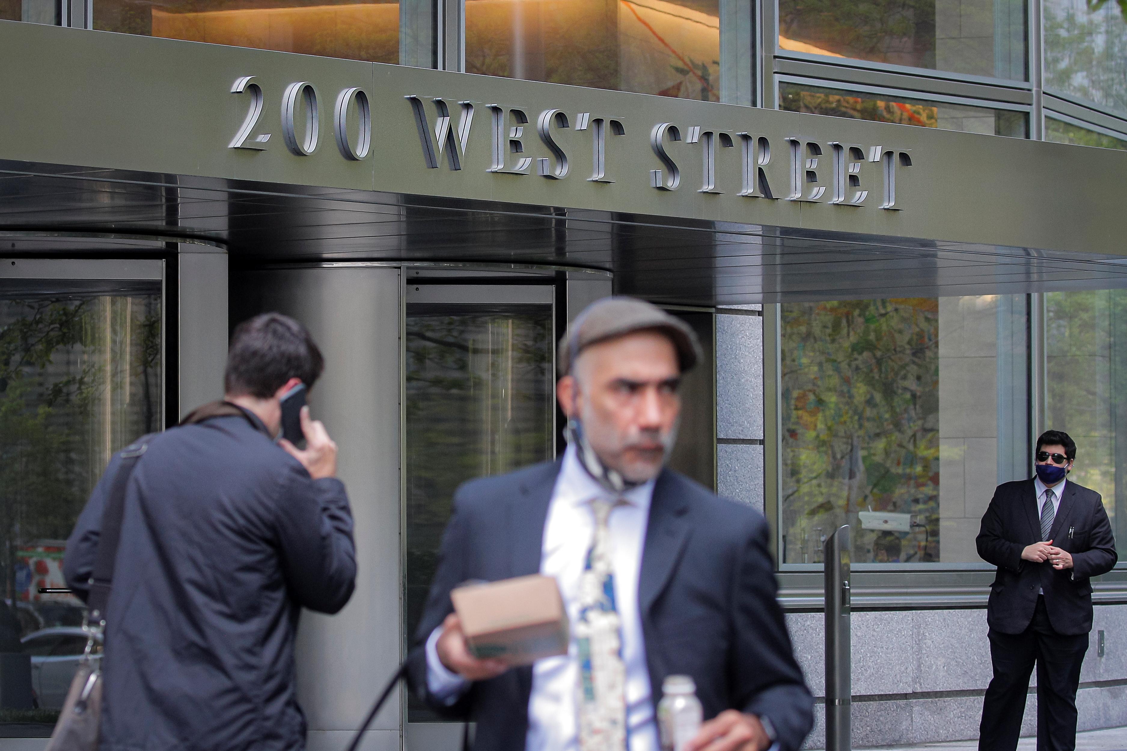 Workers walk outside 200 West Street, the Goldman Sachs headquarters, in New York City, U.S., May 4, 2021.  REUTERS/Brendan McDermid