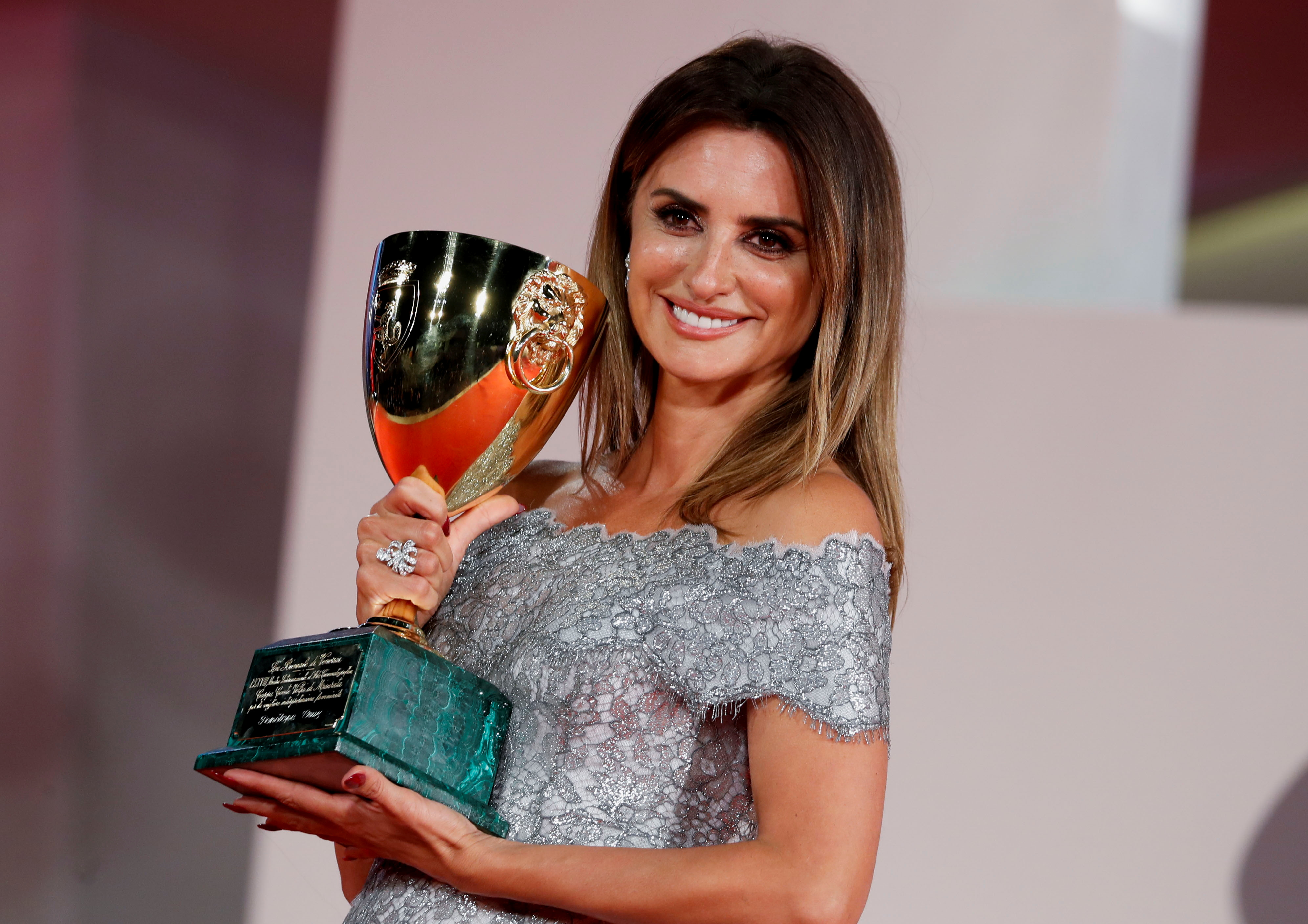 The 78th Venice Film Festival - Awards Ceremony - Venice, Italy, September 11, 2021 - Actor Penelope Cruz poses with her Coppa Volpi Award for Best Actress. REUTERS/Yara Nardi