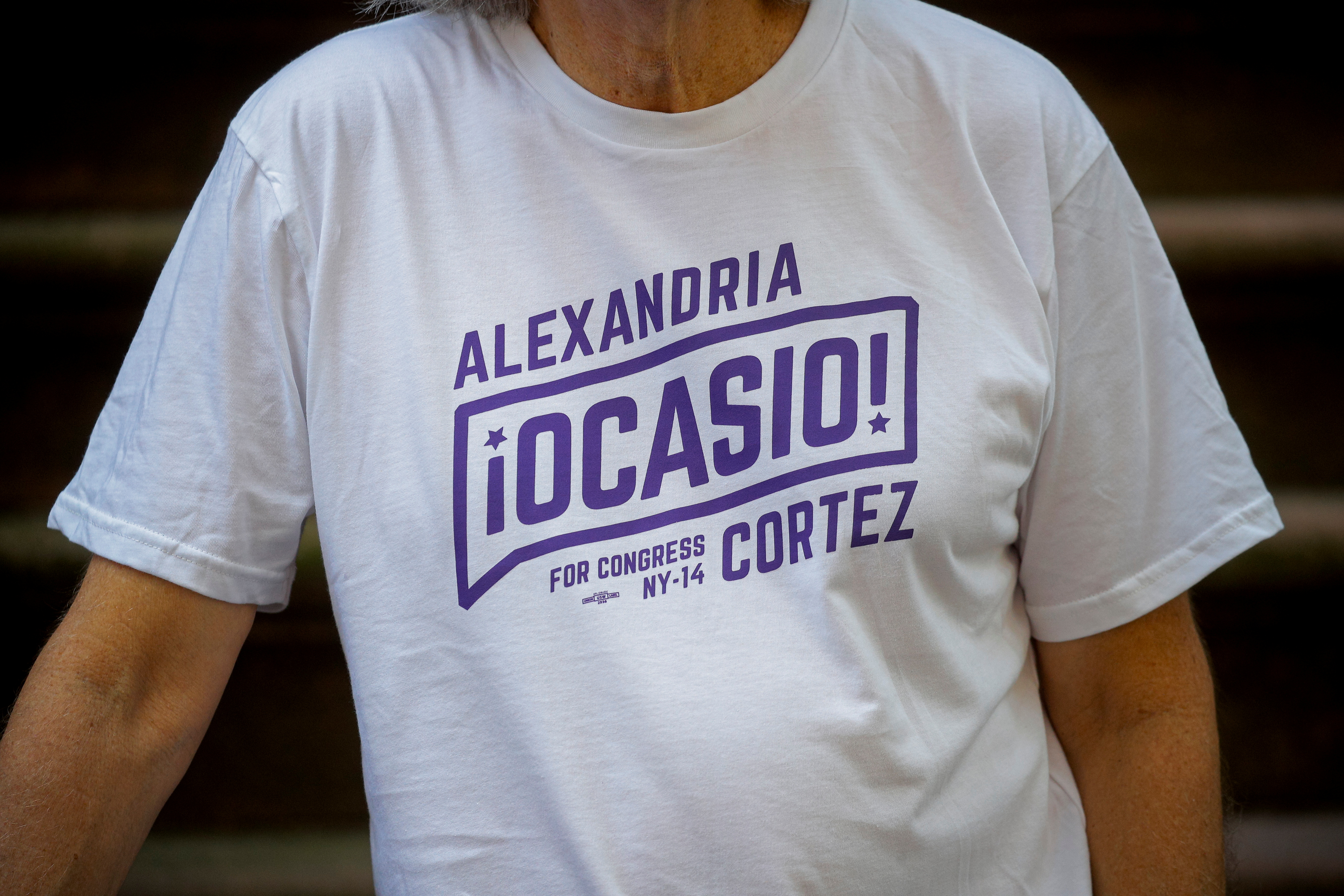 Peter Hogness poses wearing his Alexandria Ocasio-Cortez branded T-shirt in the Park Slope area of Brooklyn in New York City, U.S., July 16, 2021.  REUTERS/Brendan McDermid