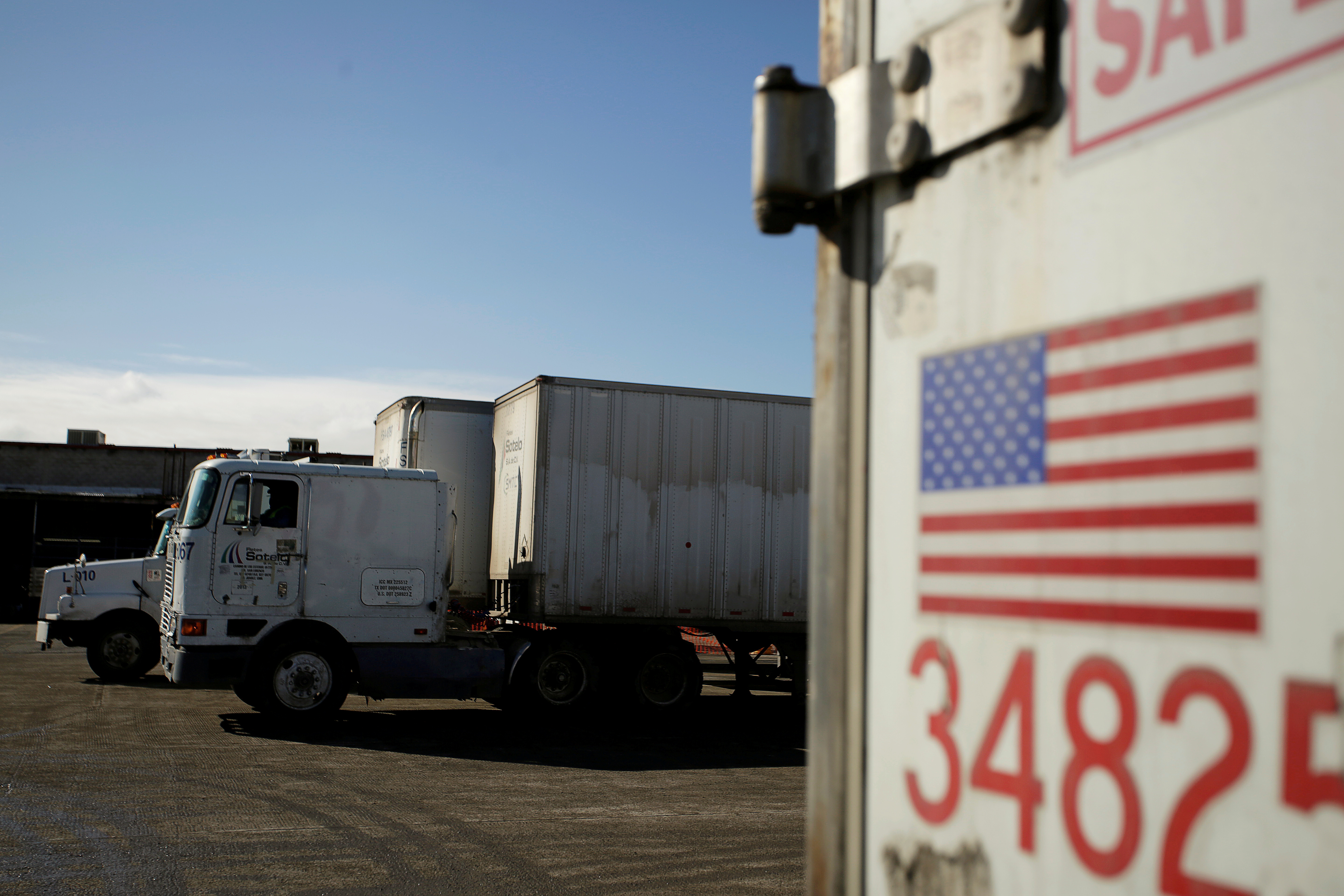 A U.S. flag is pictured on a truck loaded with merchandise at the freight shipping company Sotelo, which transports goods between Mexico and the United States, in Ciudad Juarez, Mexico, December 10, 2019. REUTERS/Jose Luis Gonzalez/