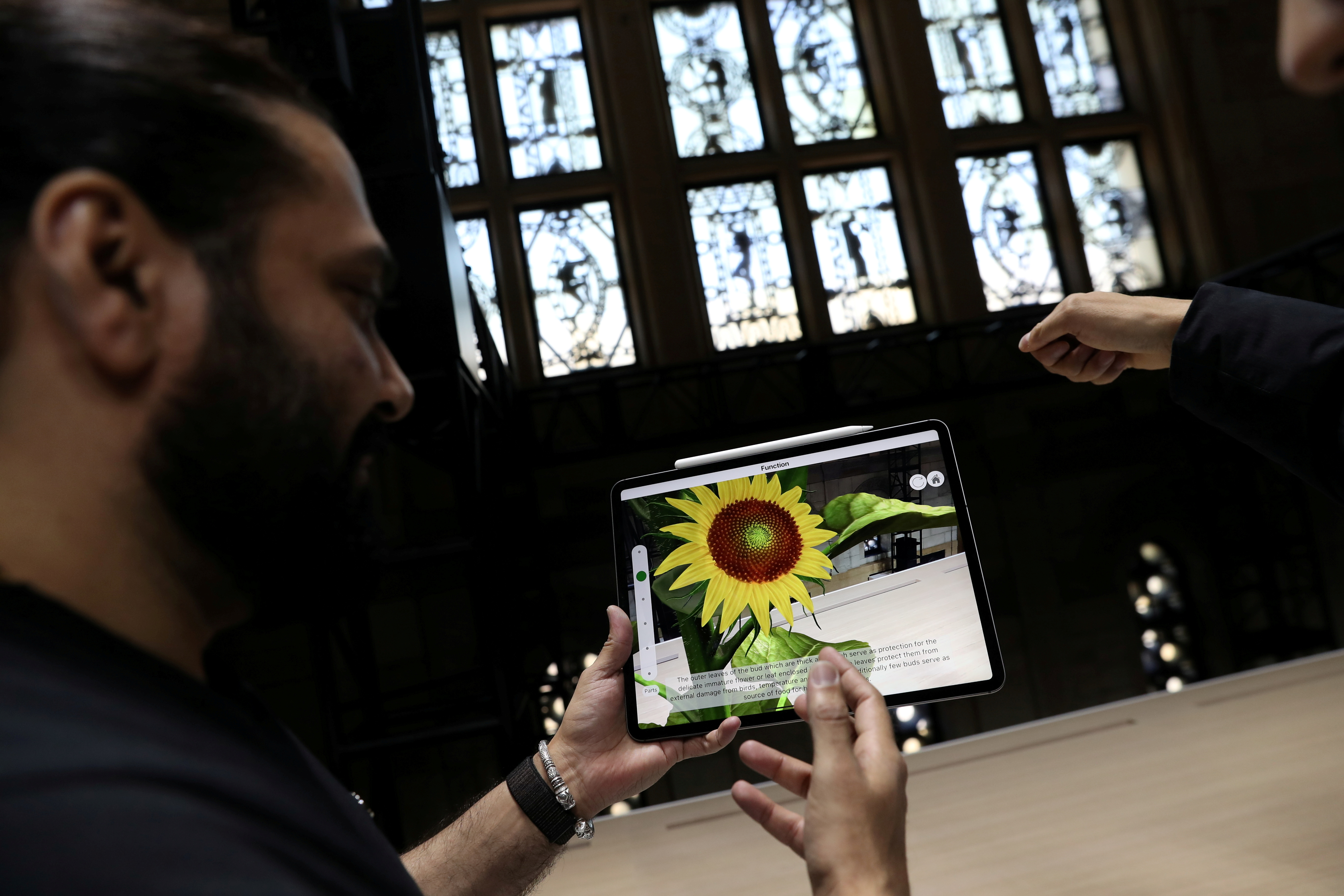 Attendees try out the new iPad Pro during an Apple launch event in the Brooklyn borough of New York, U.S., October 30, 2018. REUTERS/Shannon Stapleton/File Photo