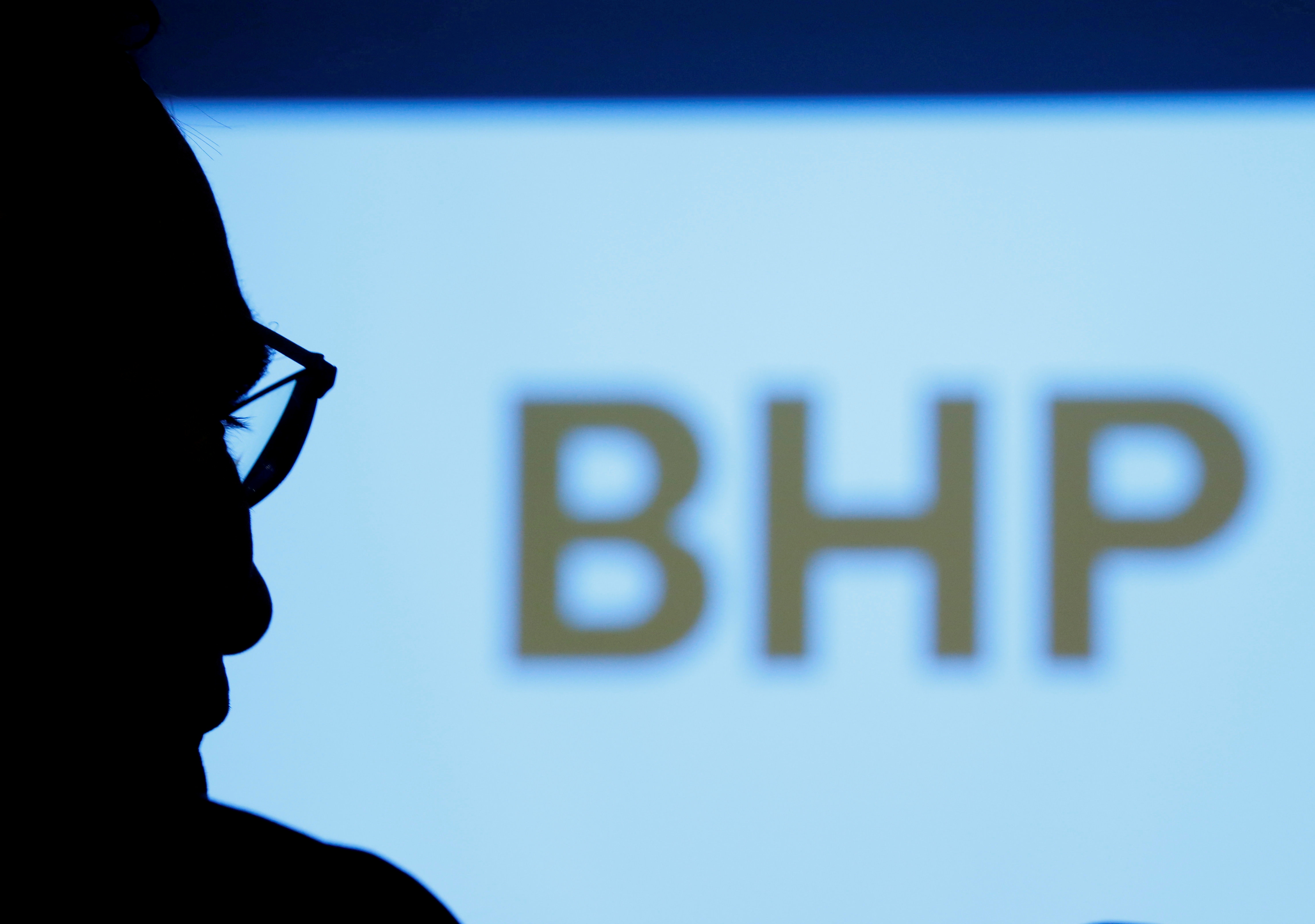 BHP's logo is projected on a screen during a round-table meeting with journalists in Tokyo, Japan, June 5, 2017. REUTERS/Kim Kyung-Hoon