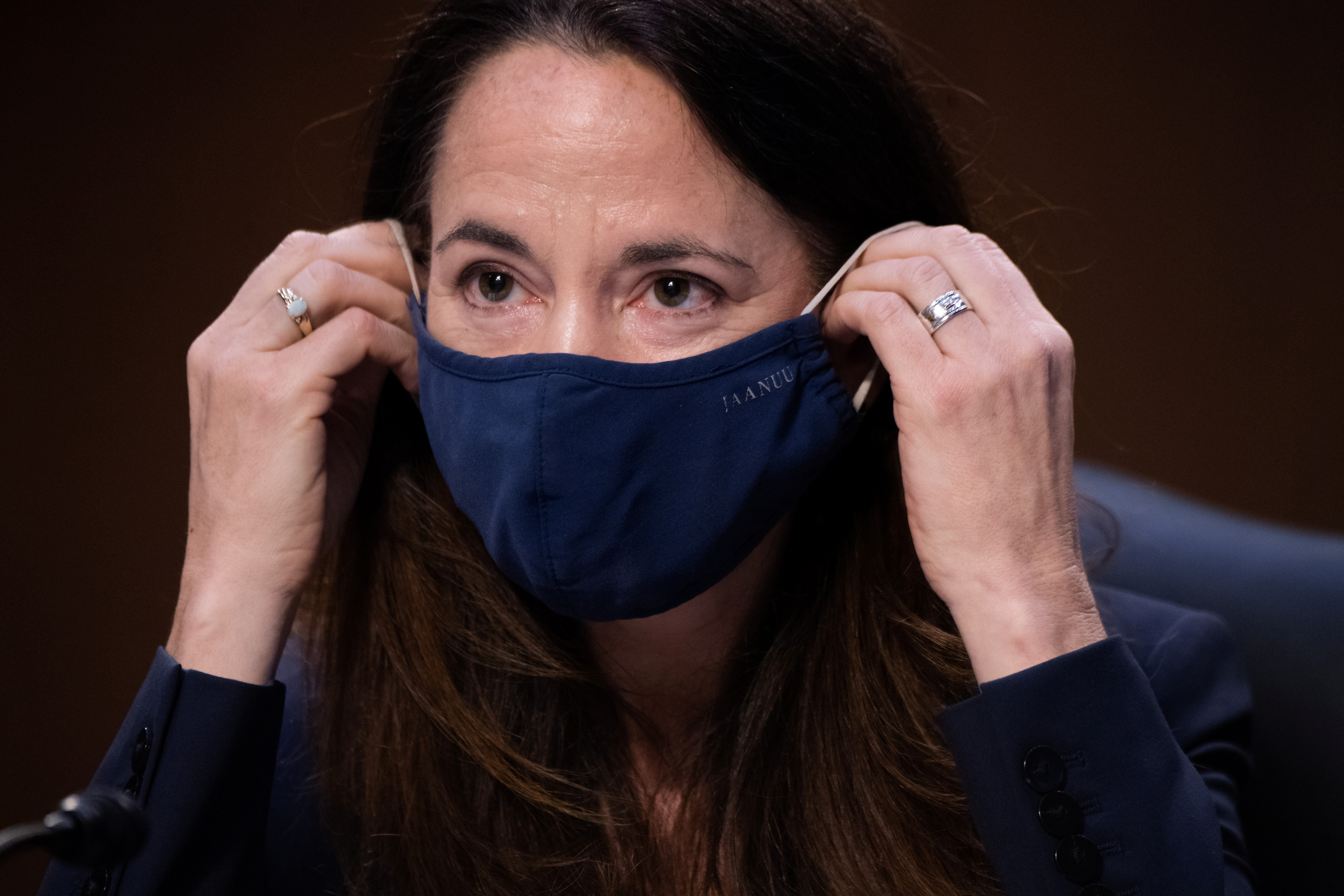 Director Avril Haines of the Office of the Director of National Intelligence (ODNI) adjusts her mask as she testifies during a Senate Select Committee on Intelligence hearing about worldwide threats, on Capitol Hill in Washington, DC, U.S., April 14, 2021. Saul Loeb/Pool via REUTERS