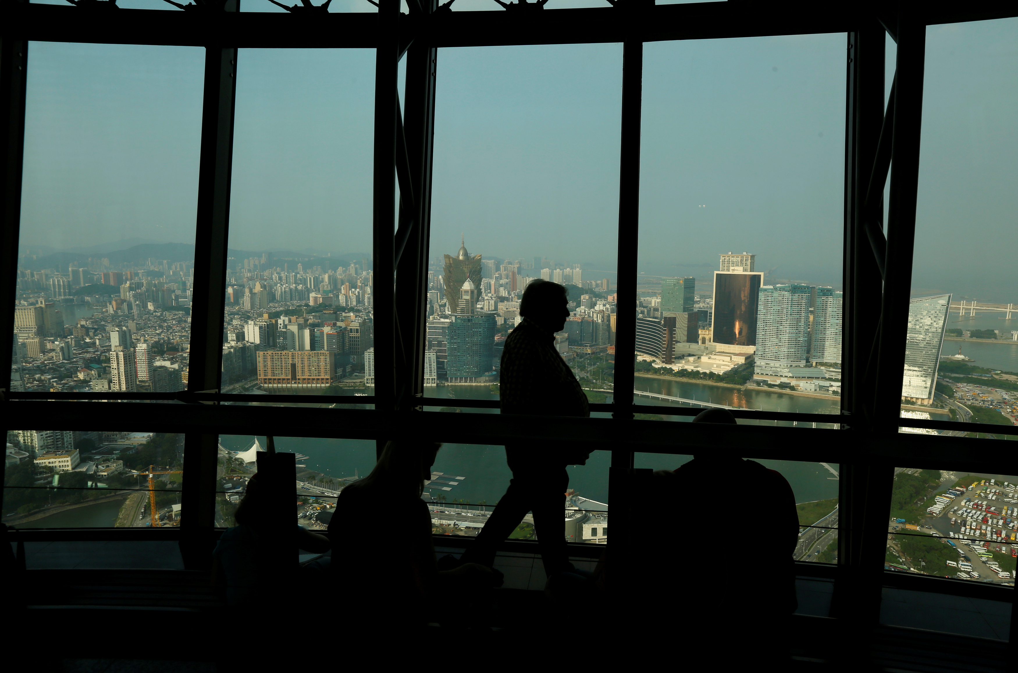 A visitor walks inside Macau Tower overlooking the skyline of Macau peninsula, China October 8, 2015. Picture taken October 8, 2015. REUTERS/Bobby Yip