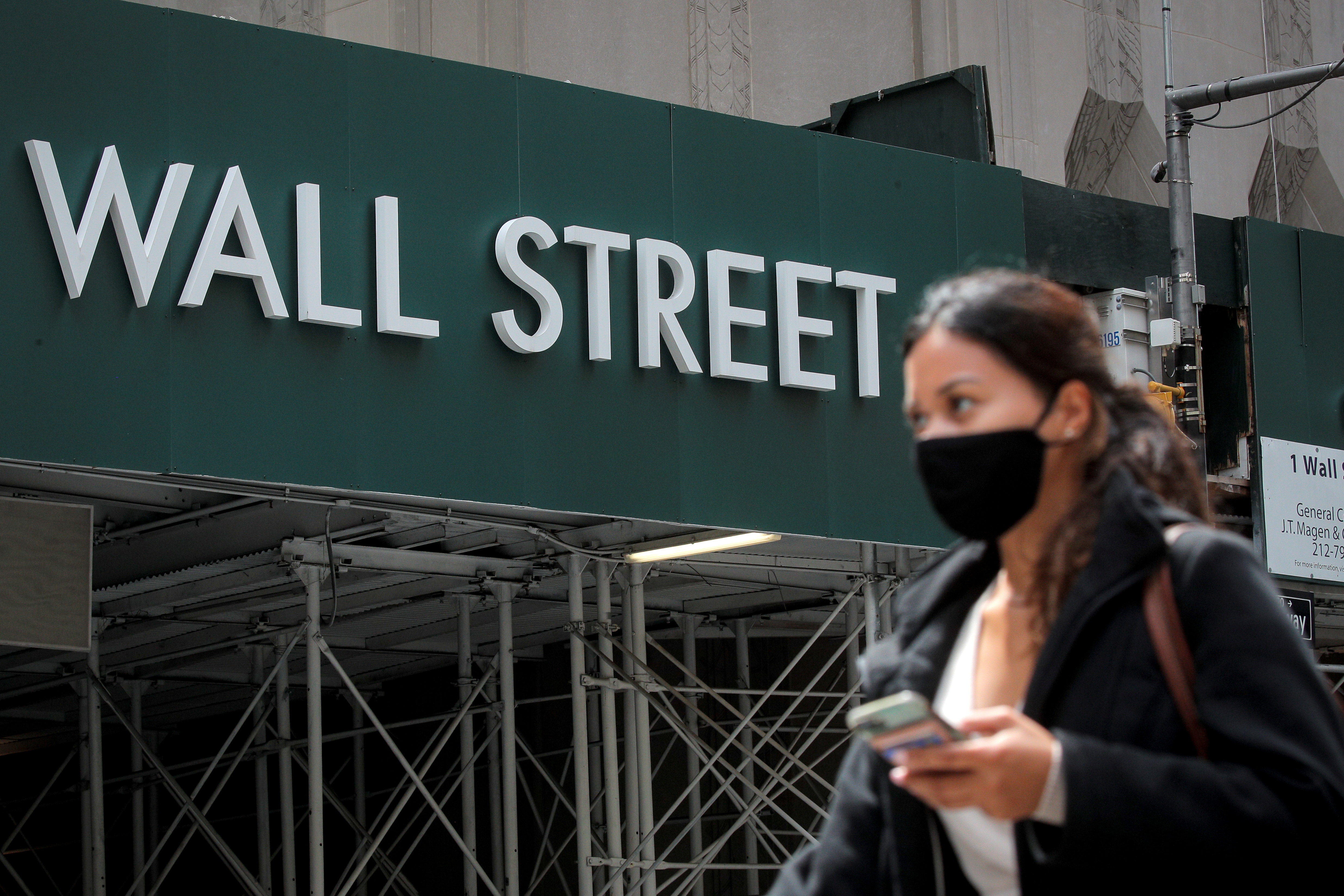 A Wall St. sign is seen near the New York Stock Exchange (NYSE) in New York City, U.S., May 4, 2021.  REUTERS/Brendan McDermid/File Photo