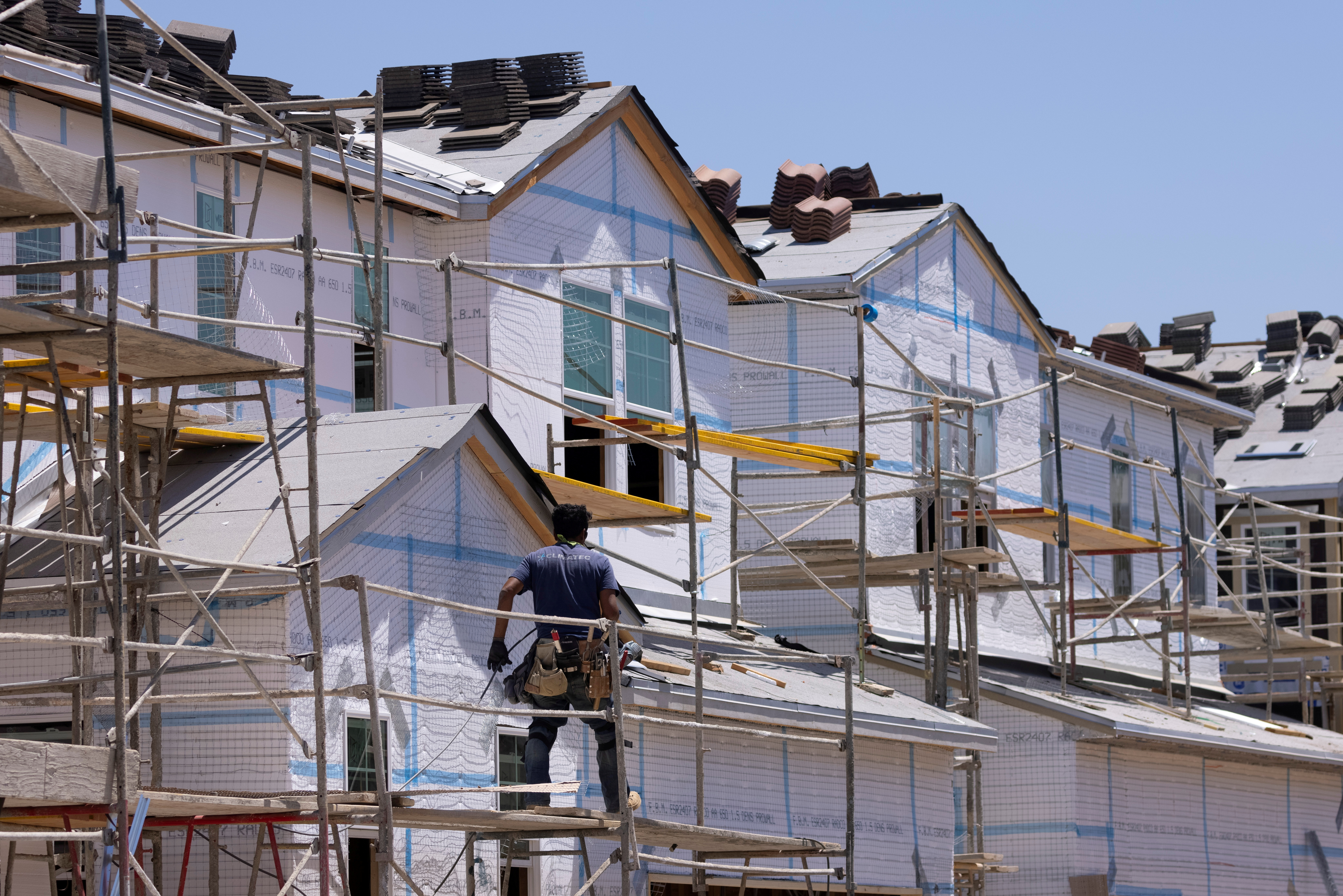 Residential single family homes construction by KB Home are shown under construction in the community of Valley Center, California, U.S. June 3, 2021. REUTERS/Mike Blake/File Photo