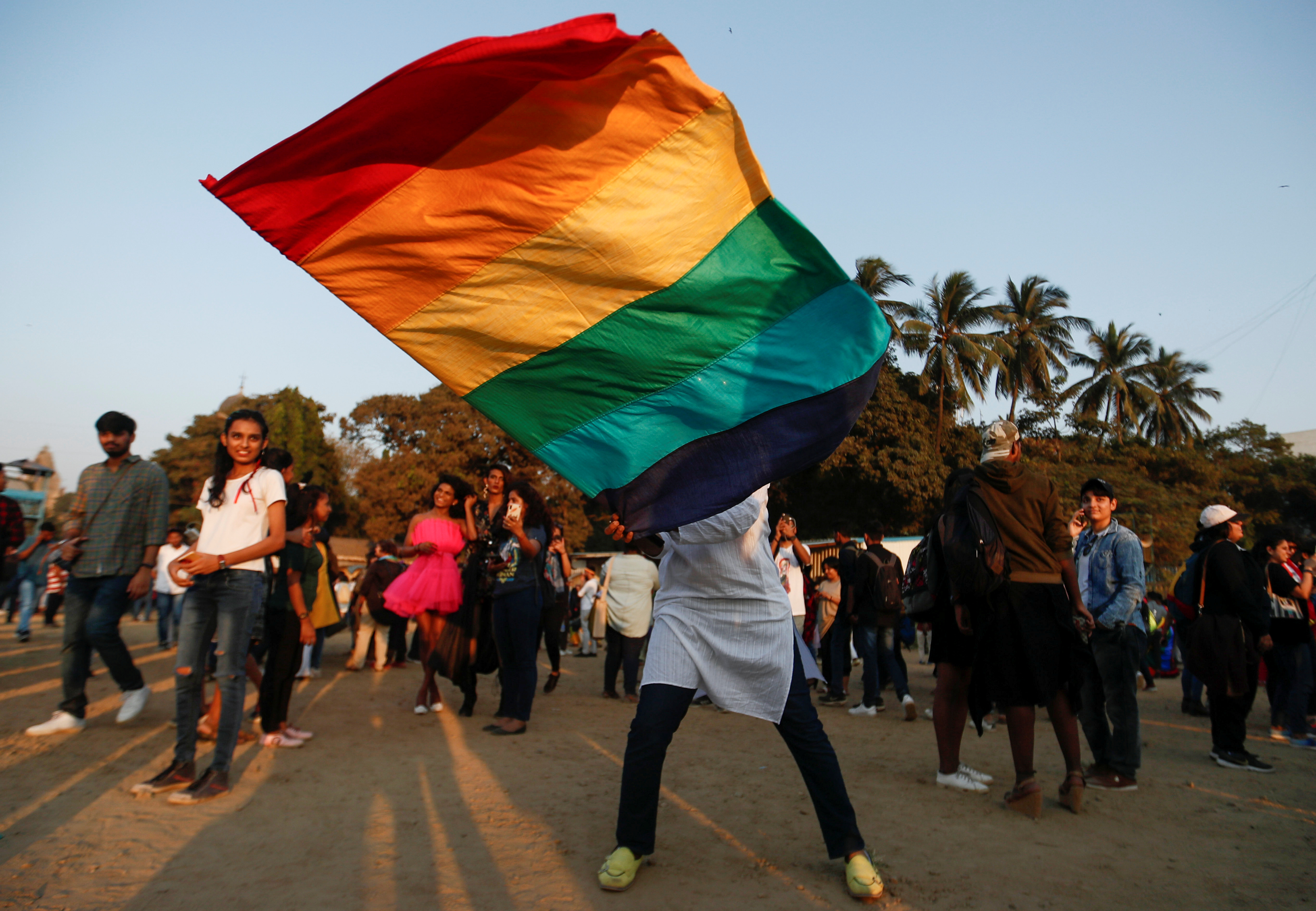 A participant waves a flag during Queer Azadi Pride, an event promoting gay, lesbian, bisexual and transgender rights, in Mumbai, India, February 1, 2020. REUTERS/Francis Mascarenhas