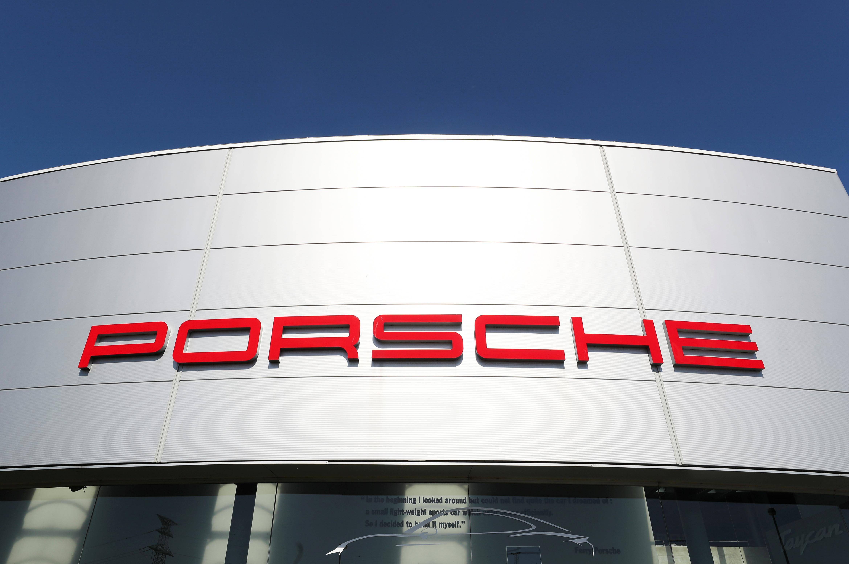 A logo of Porsche is seen outside a Porsche car dealer, amid the coronavirus disease (COVID-19) outbreak in Brussels, Belgium May 28, 2020. REUTERS/Yves Herman