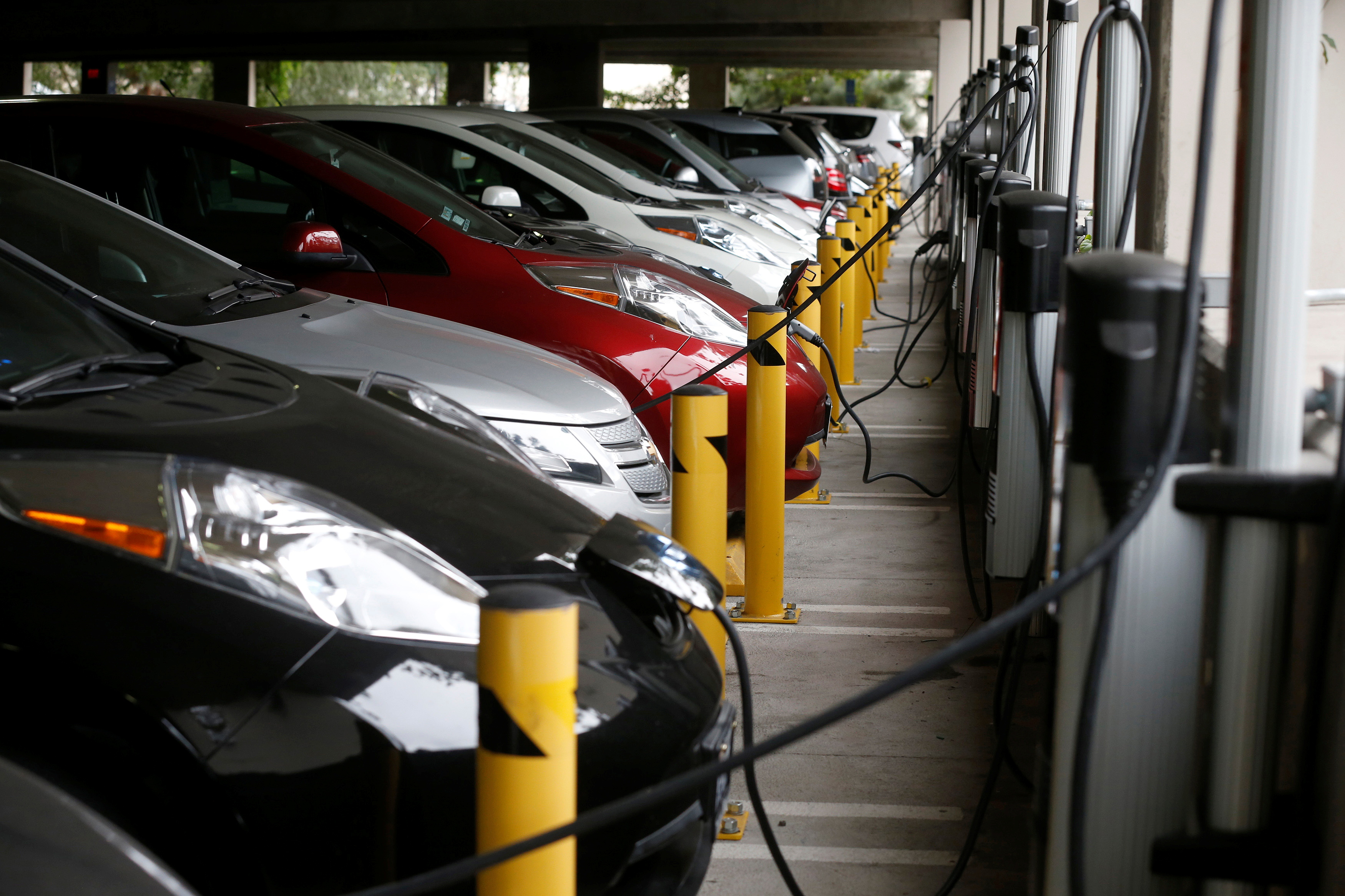 Electric cars sit charging in a parking garage at the University of California, Irvine January 26, 2015. REUTERS/Lucy Nicholson