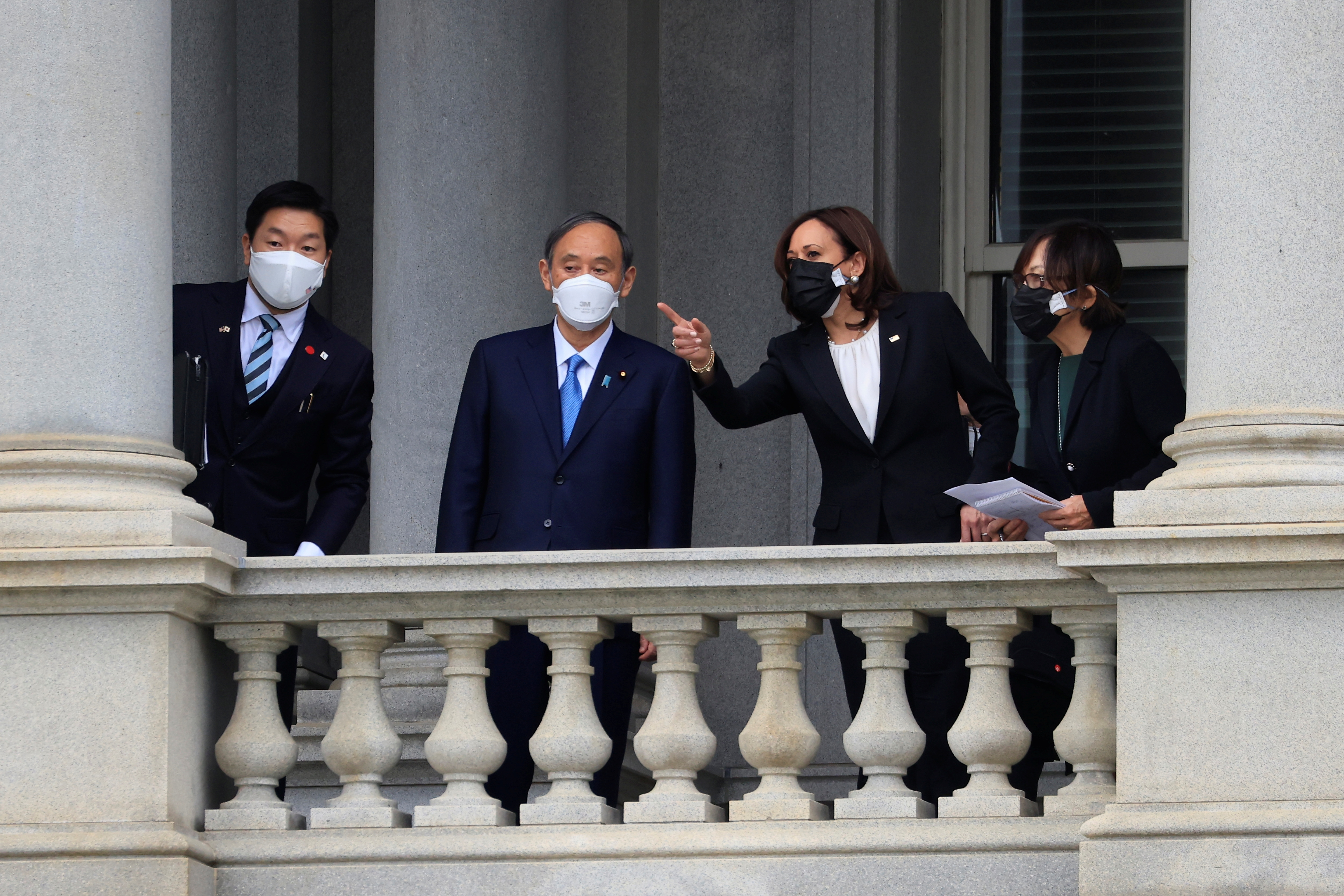 U.S. Vice President Kamala Harris and Japan?s Prime Minister Yoshihide Suga speak on a balcony at the Eisenhower Executive Office Building following a meeting at the White House in Washington, U.S., April 16, 2021. REUTERS/Tom Brenner