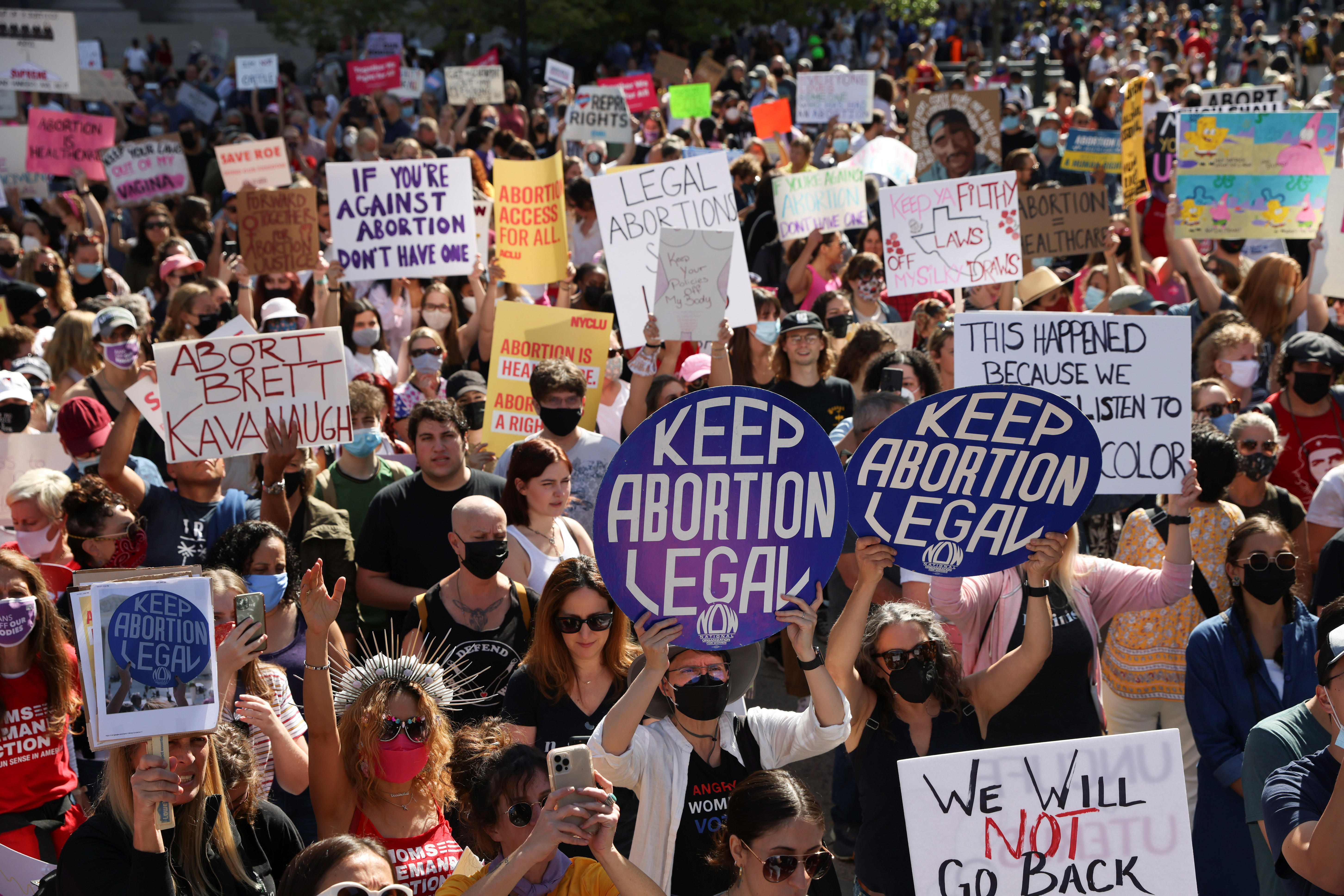 Supporters of reproductive choice take part in the nationwide Women's March in New York City, New York. October 2, 2021. REUTERS/Caitlin Ochs
