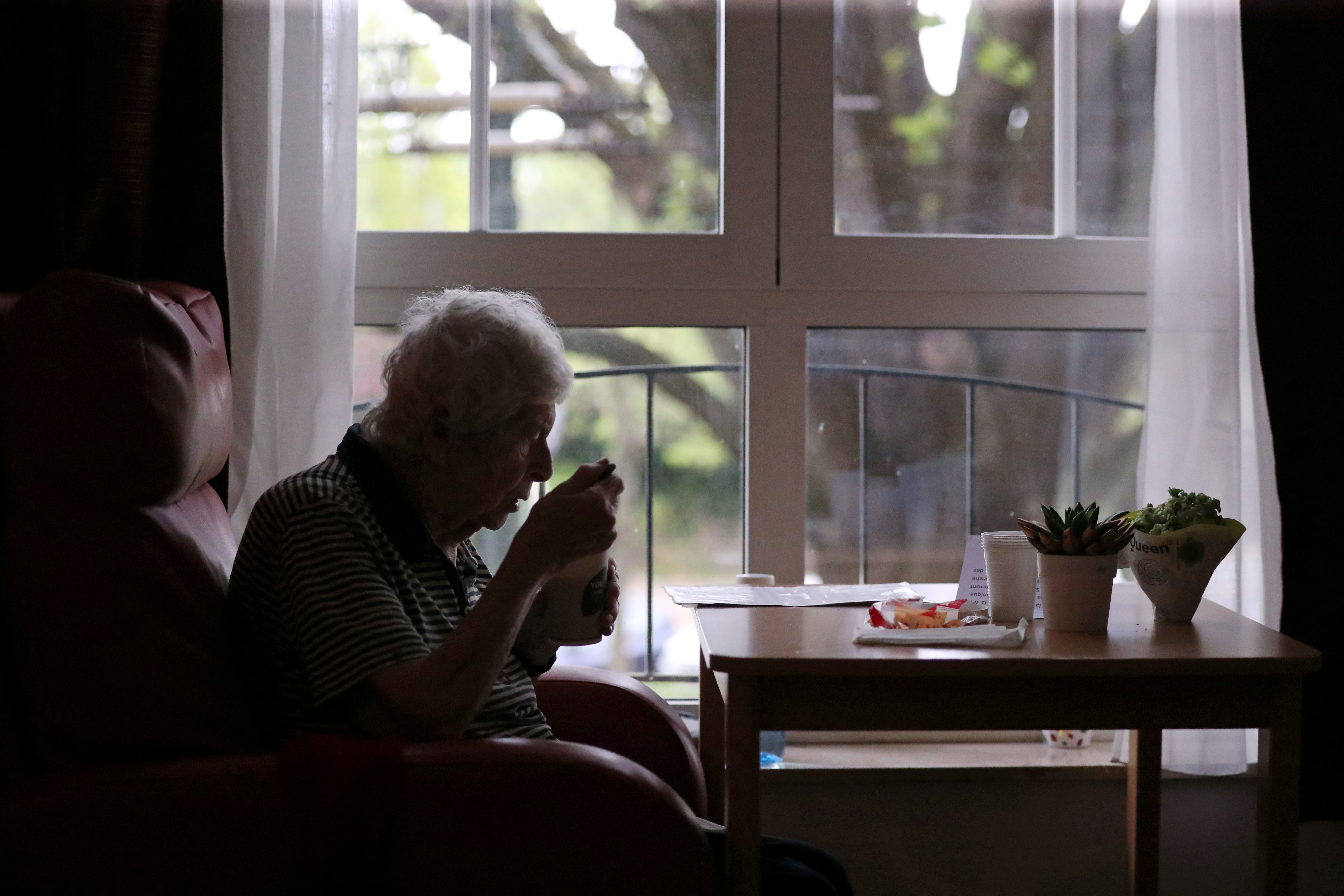 A resident eats in a room at the house for elderly Residence Christalain during coronavirus disease (COVID-19) outbreak, in the Brussels commune of Jette, Belgium April 13, 2020. REUTERS/Yves Herman/File Photo