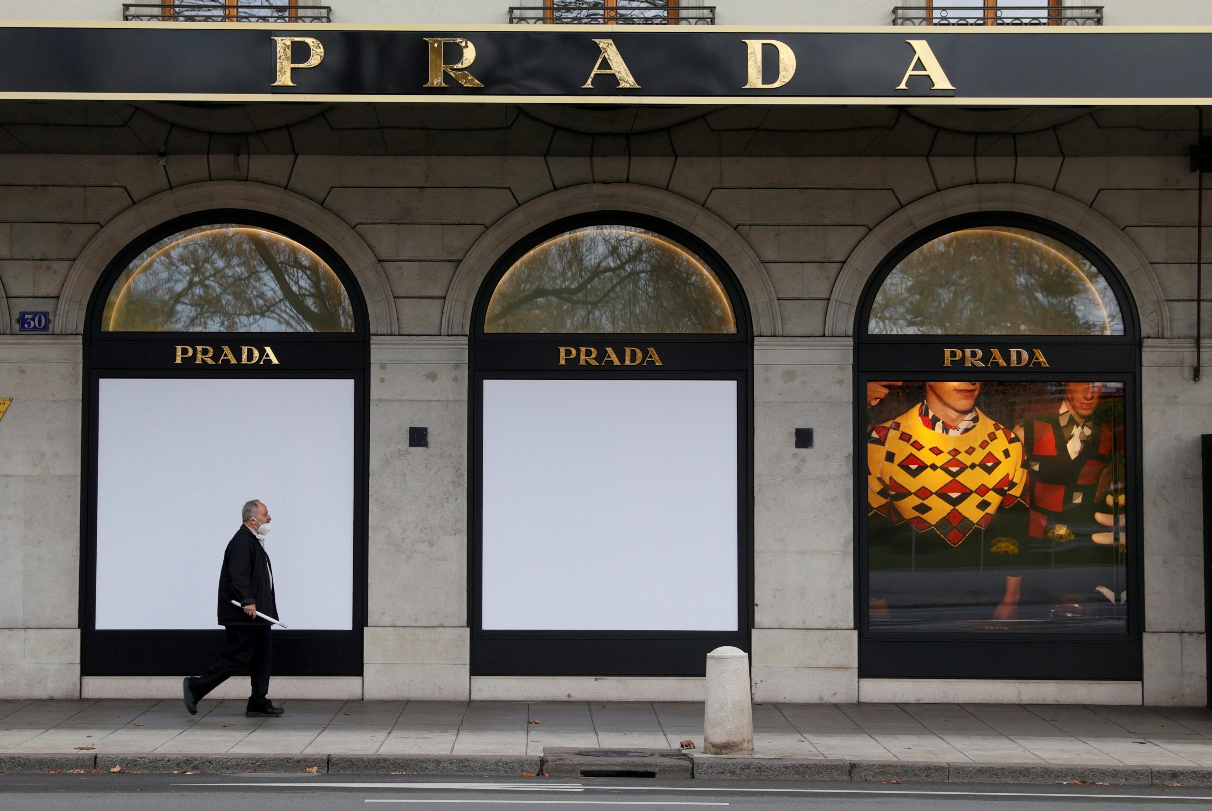 A man walks past a closed Prada shop after partial lockdown measures were introduced amid the coronavirus disease (COVID-19) outbreak in Geneva, Switzerland, November 16, 2020. REUTERS/Denis Balibouse