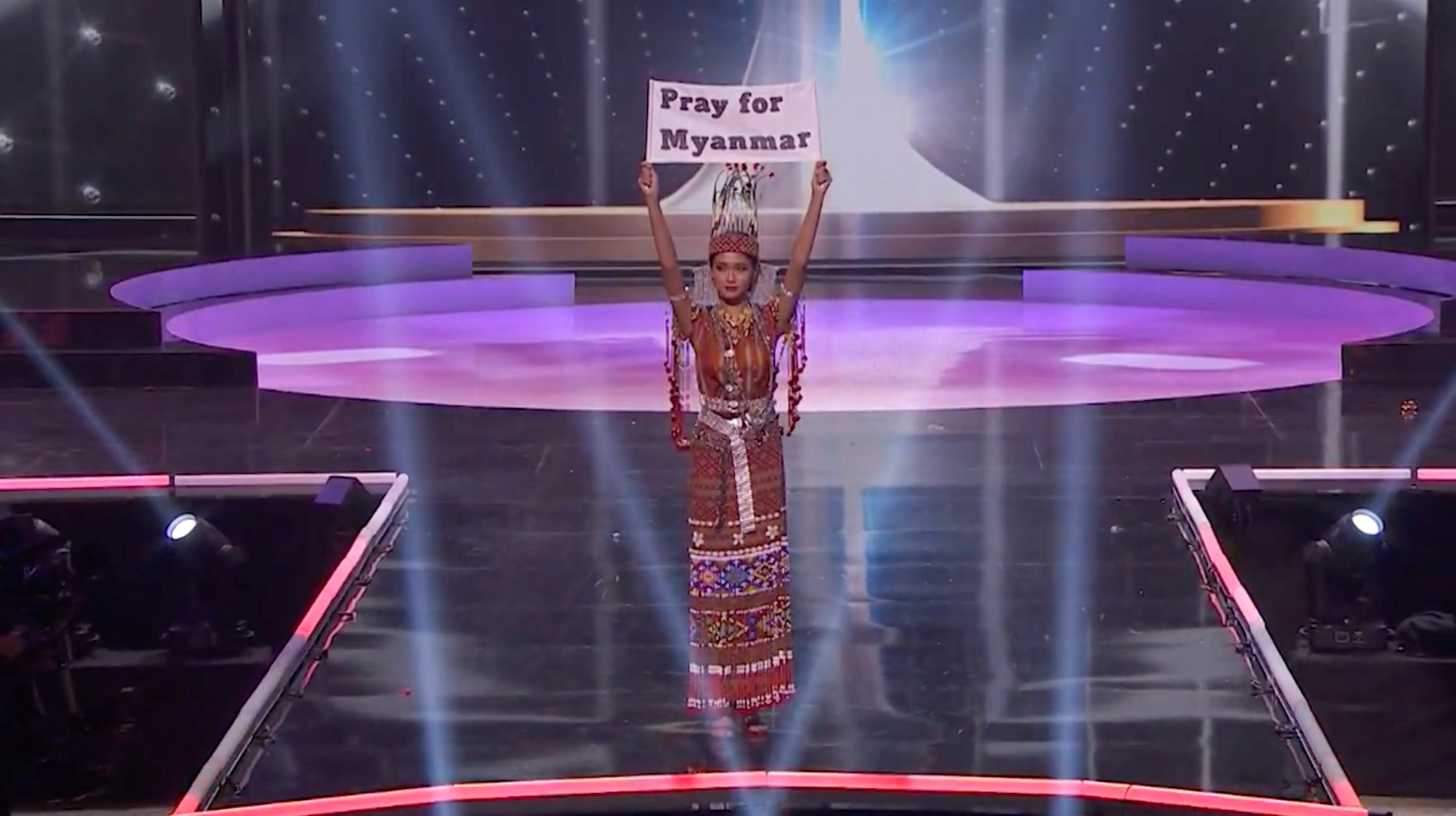 Ma Thuzar Wint Lwin, Miss Universe Myanmar, holds up the