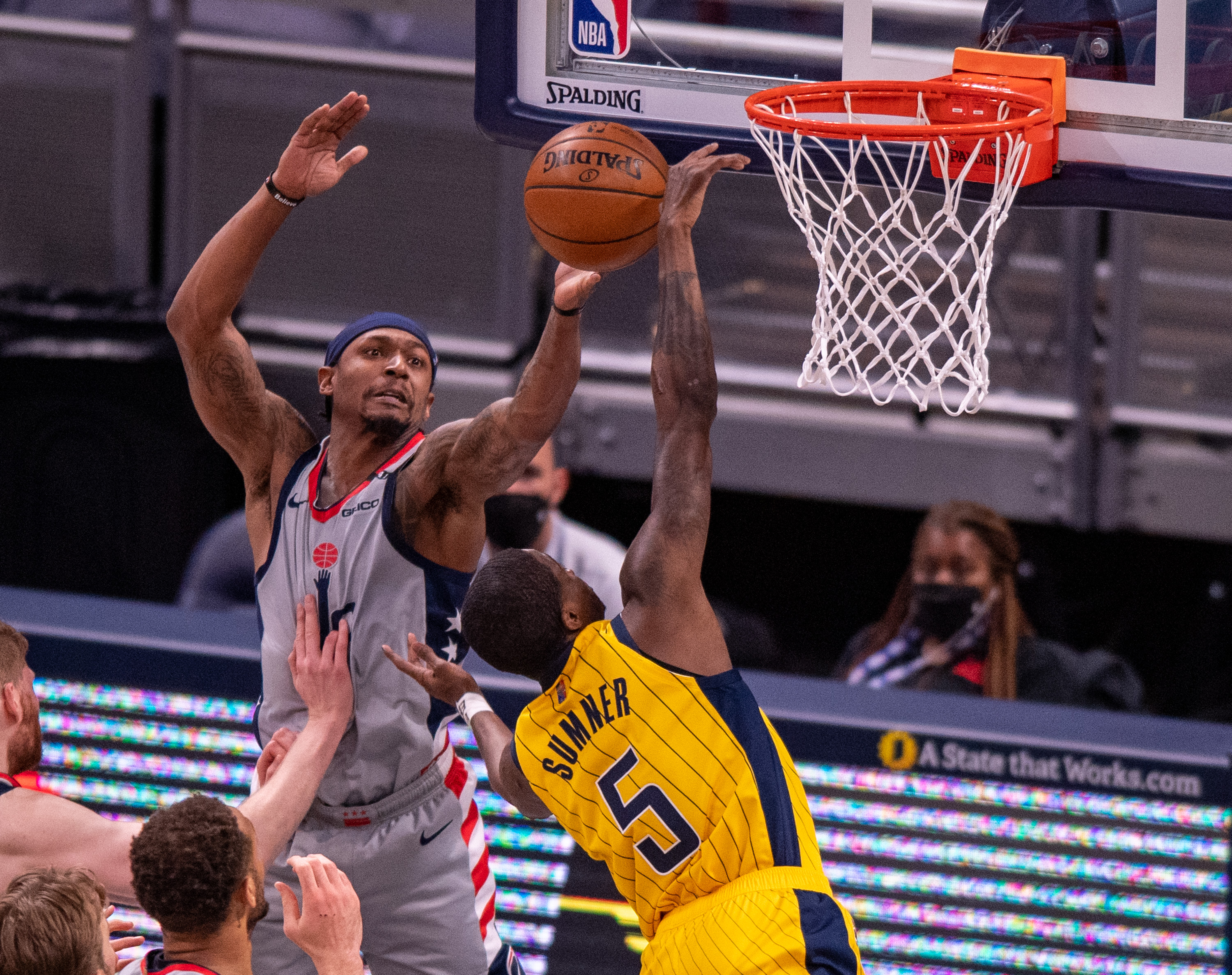 May 8, 2021; Indianapolis, Indiana, USA; Washington Wizards guard Bradley Beal (3) attempts to block a shot by Indiana Pacers guard Edmond Sumner (5) during the second half of an NBA basketball game at Bankers Life Fieldhouse. Mandatory Credit: Doug McSchooler-USA TODAY Sports