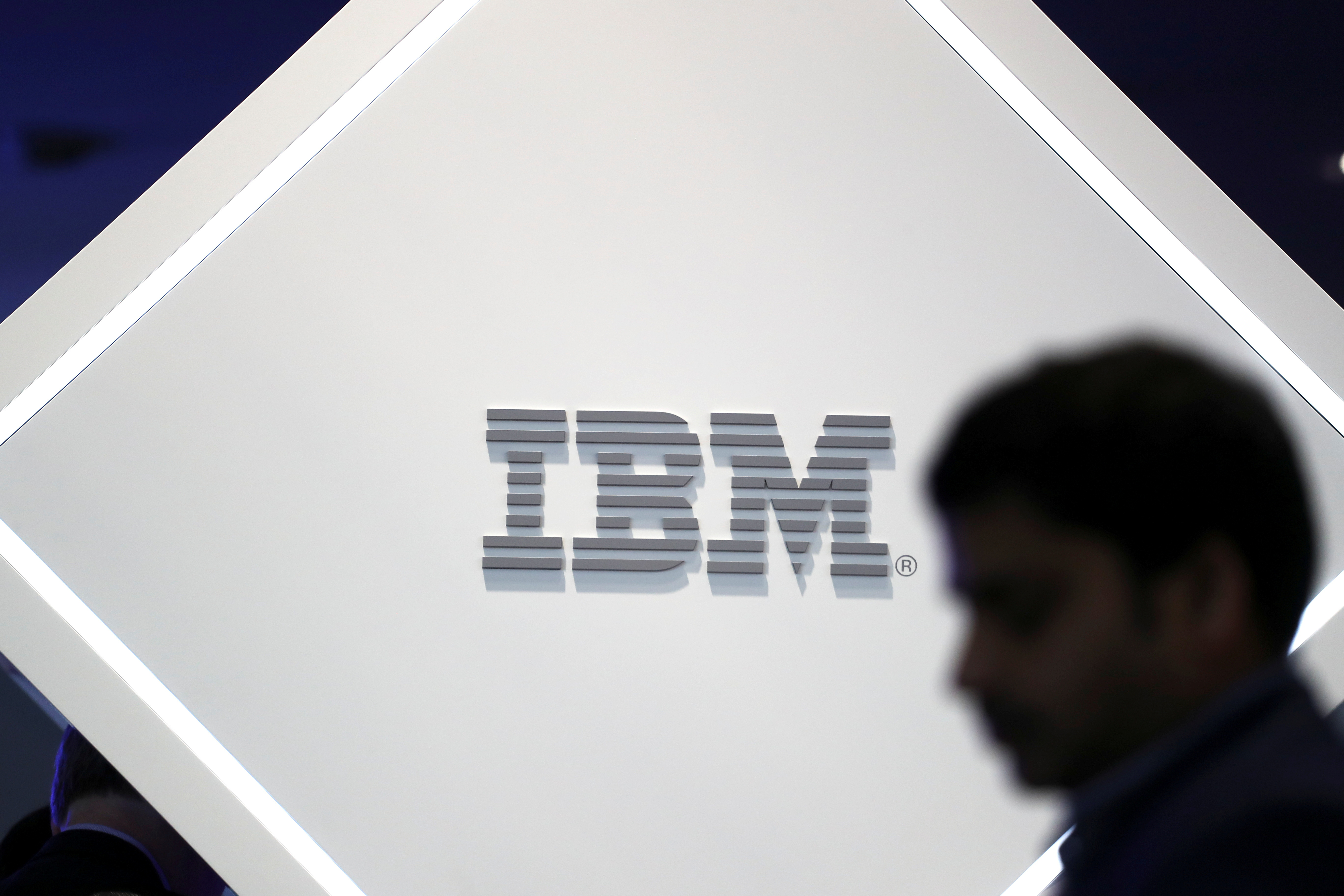 A man stands near an IBM logo at the Mobile World Congress in Barcelona, Spain, February 25, 2019. REUTERS/Sergio Perez