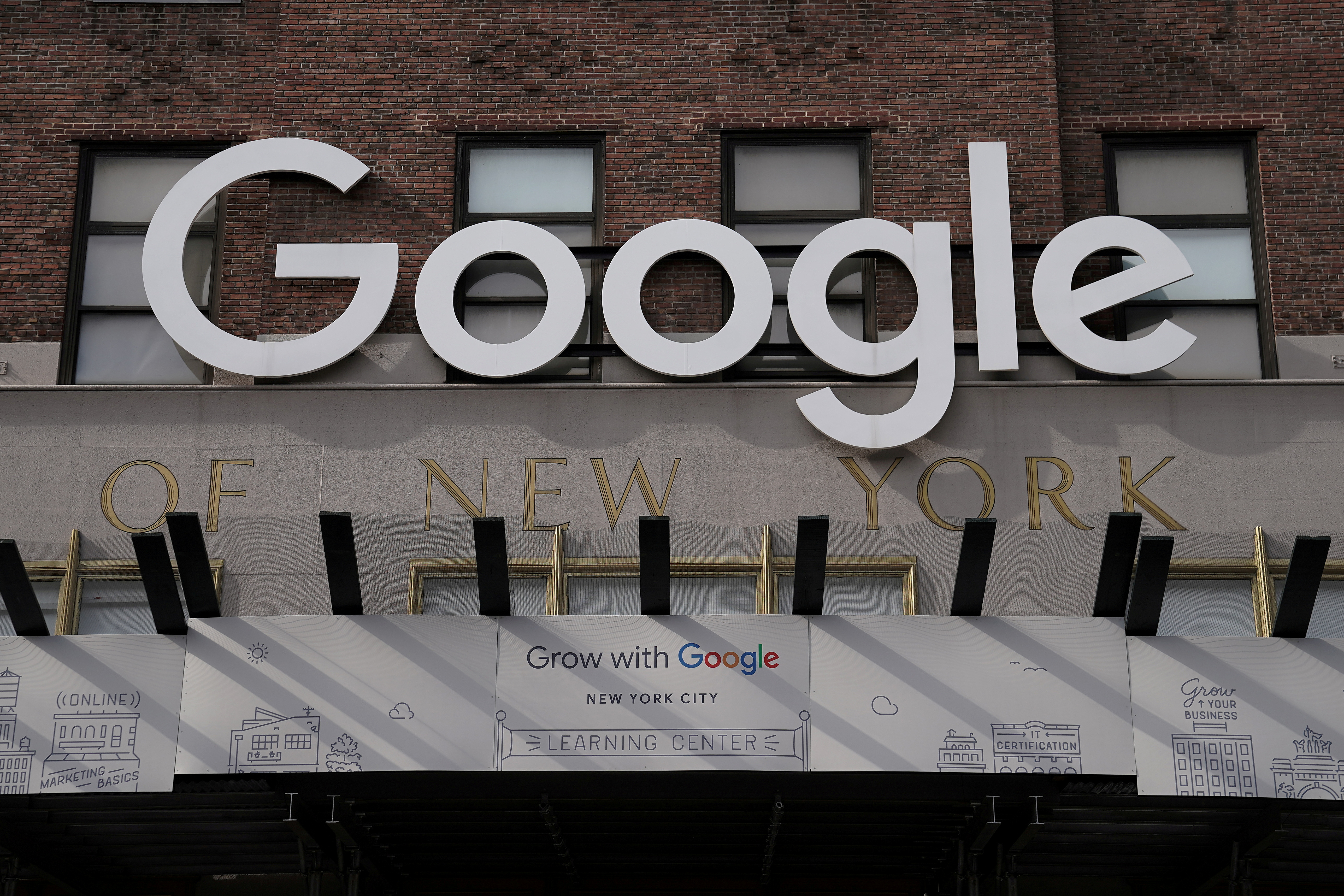 A Google sign is pictured on a Google building in the Manhattan borough of New York City, New York, U.S., October 20, 2020. REUTERS/Carlo Allegri