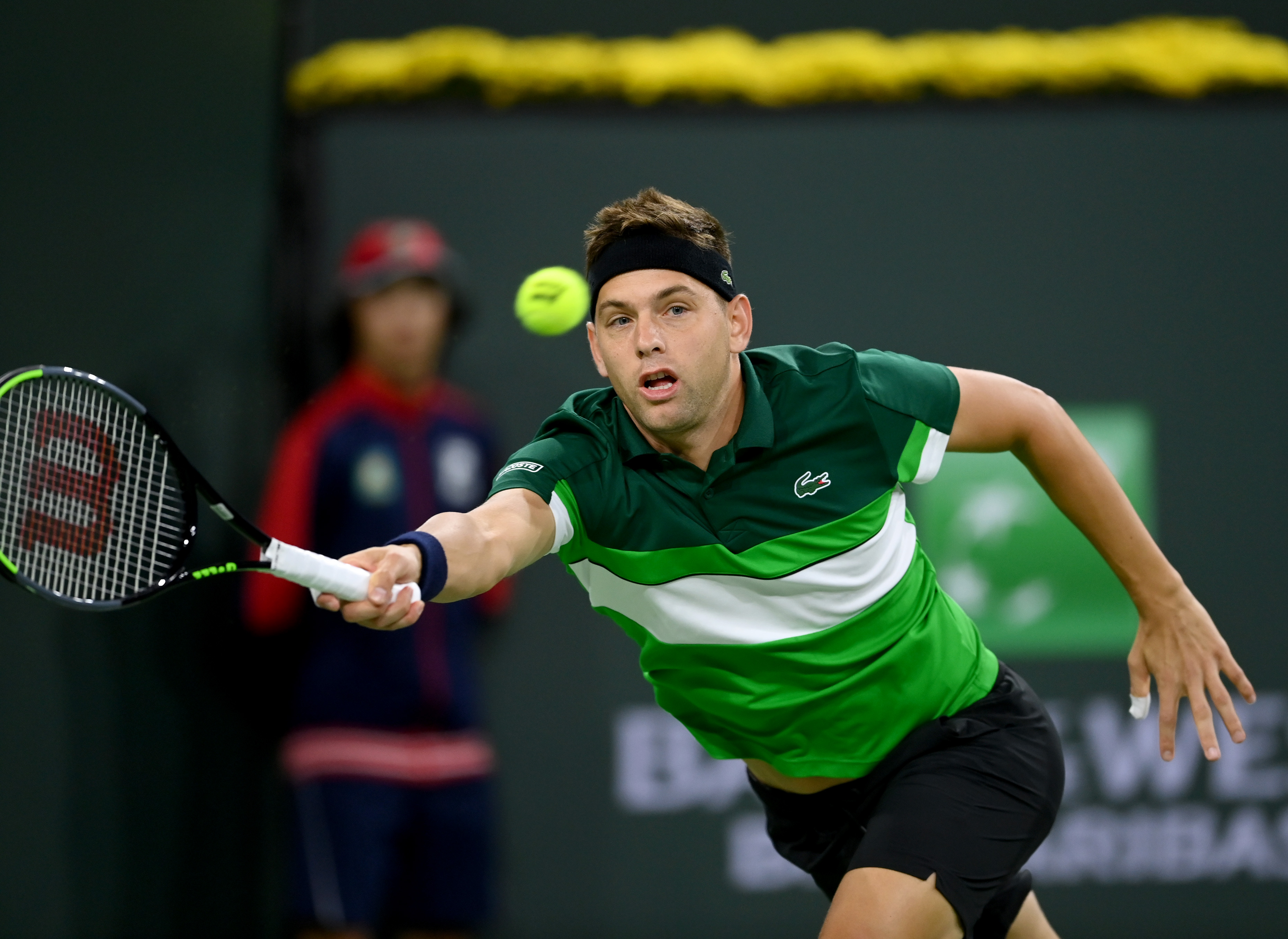 Oct 11, 2021; Indian Wells, CA, USA; Filip Krajinovic (SRB) hits a shot against Daniil Medvedev (RUS) during a third round match in the BNP Paribas Open at the Indian Wells Tennis Garden. Mandatory Credit: Jayne Kamin-Oncea-USA TODAY Sports