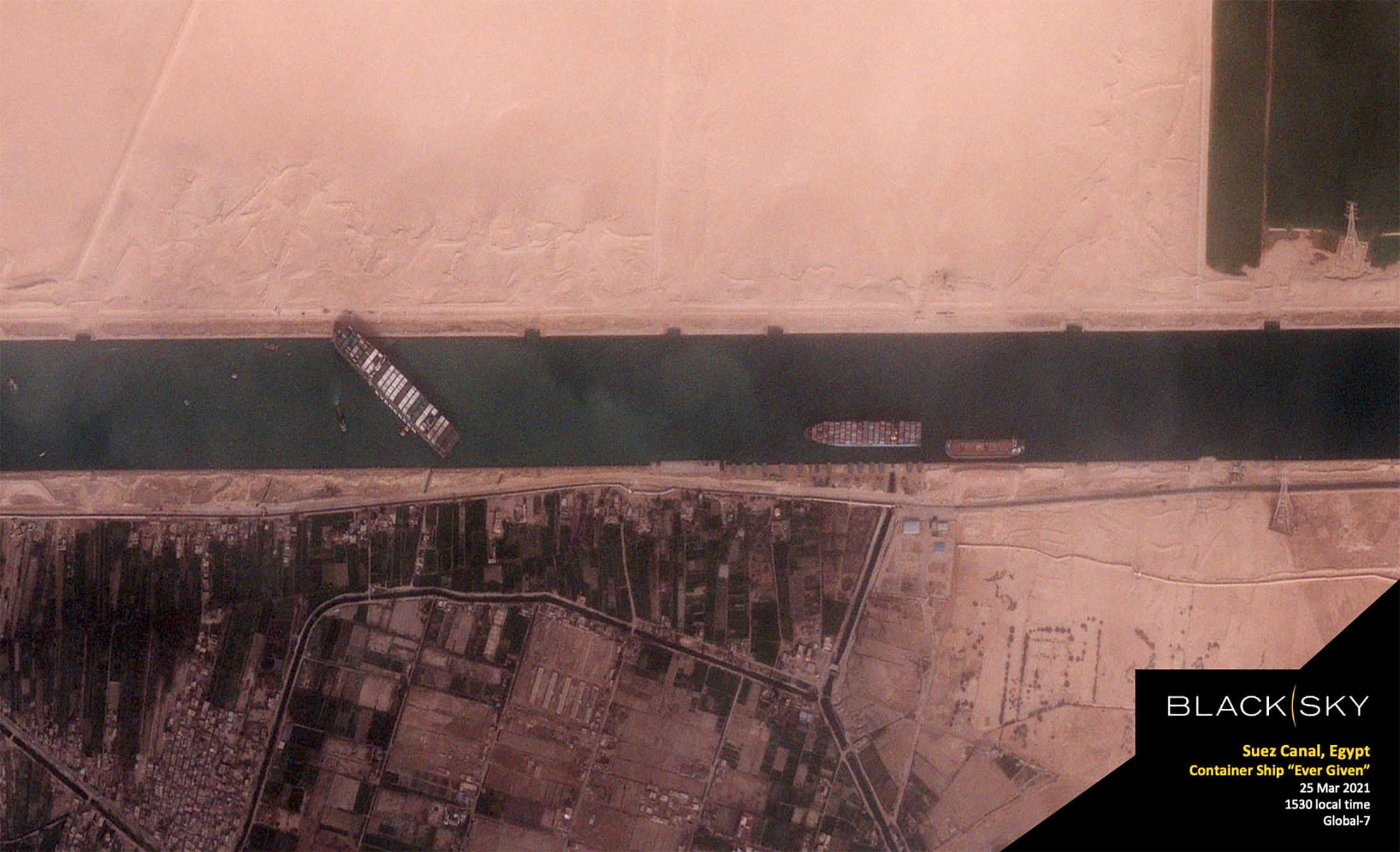 The 400-meter, 224,000-tonne Ever Given container ship, leased by Taiwan's Evergreen Marine Corp, blocks Egypt's Suez Canal in a BlackSky satellite image taken at 15:30 local time March 25, 2021. BlackSky/Handout via REUTERS