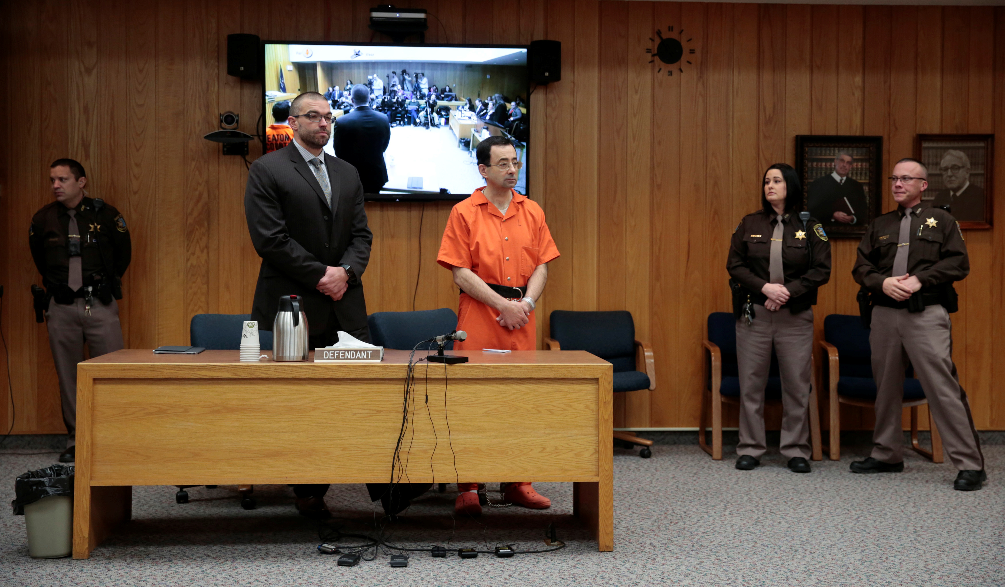 Larry Nassar, a former team USA Gymnastics doctor who pleaded guilty in November 2017 to sexual assault charges, and his defense attorney Matt Newburg stand during Nassar's sentencing hearing in the Eaton County Court in Charlotte, Michigan, U.S., February 5, 2018.  REUTERS/Rebecca Cook