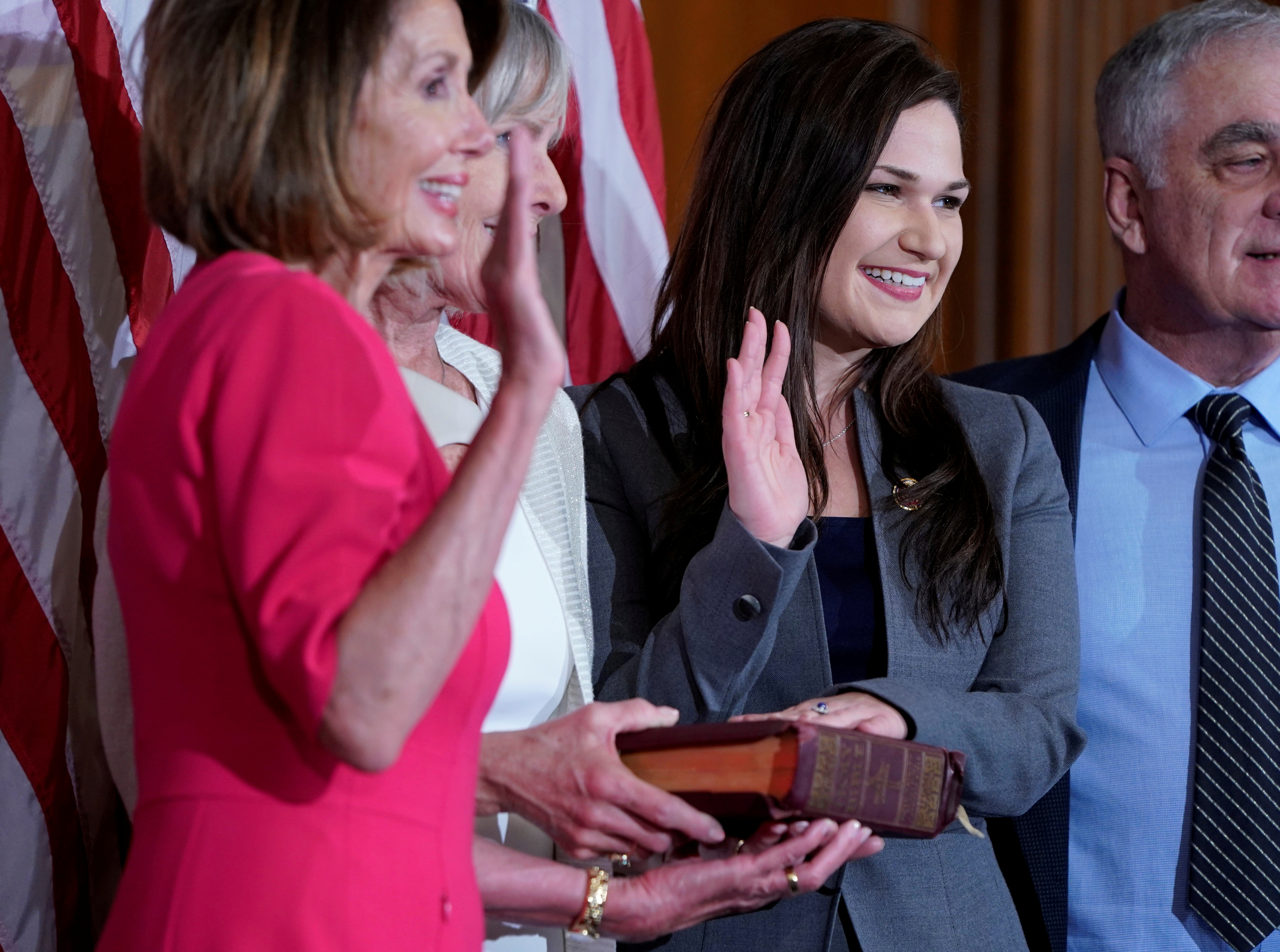 Rep. Abby Finkenauer (D-IA) poses with Speaker of the House Nancy Pelosi (D-CA) for a ceremonial swearing-in picture on Capitol Hill in Washington, U.S., January 3, 2019. REUTERS/Joshua Roberts/File Photo