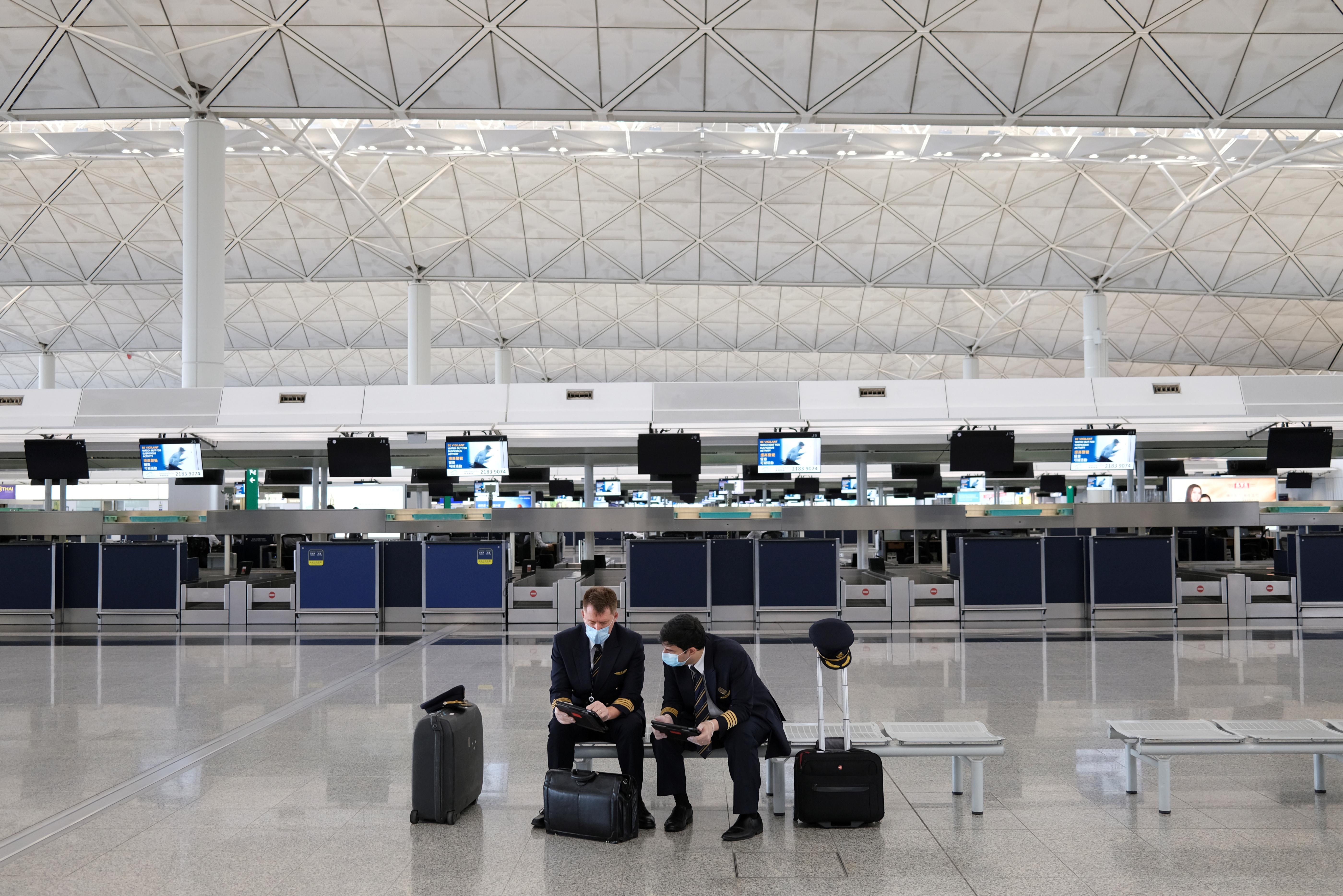 Pilots wearing face masks to avoid the spread of the coronavirus are seen at the Hong Kong International Airport, in Hong Kong, China May 7, 2020.  REUTERS/Tyrone Siu