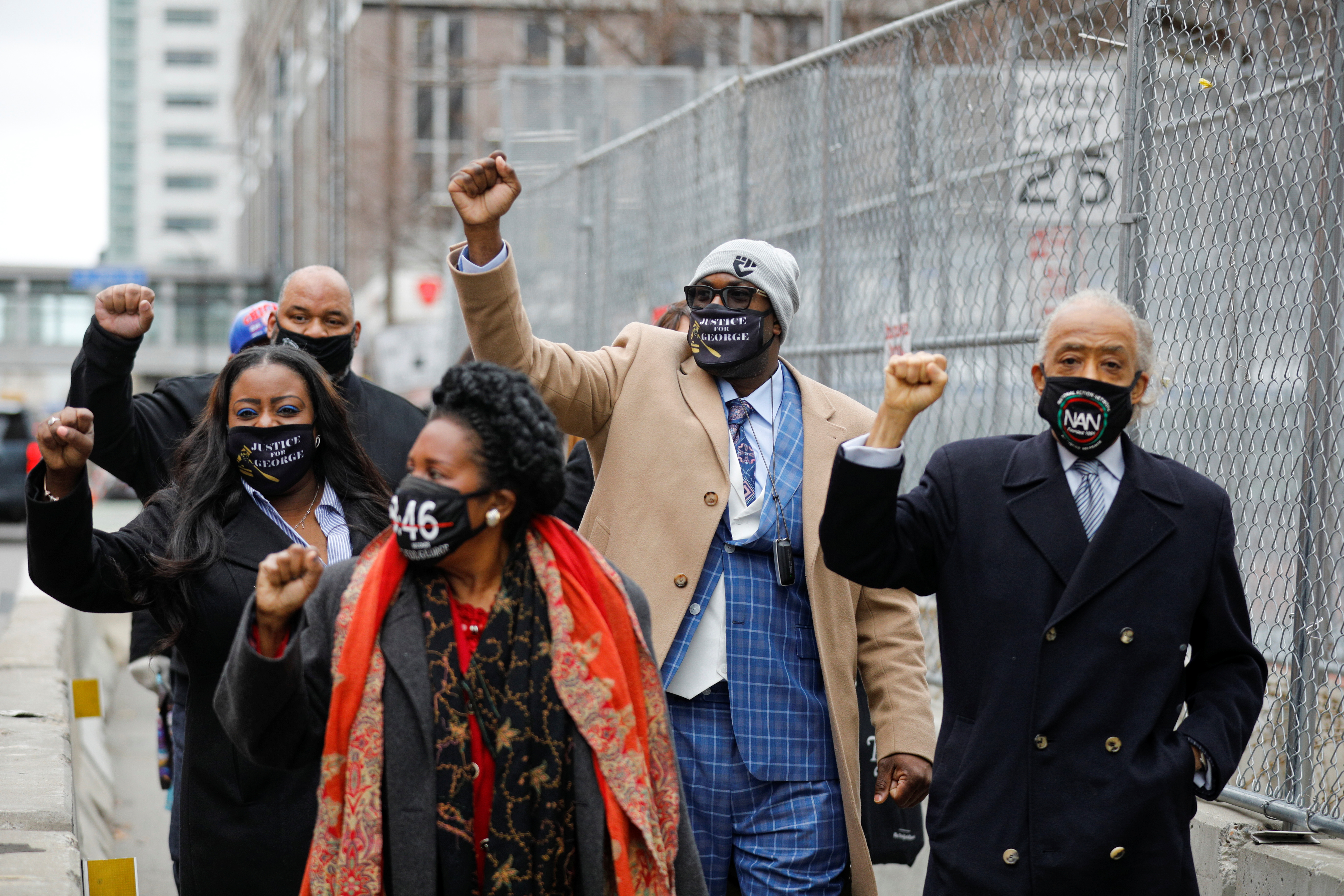 The Floyd family and Reverend Al Sharpton gesture as they arrive at the Hennepin County Government Center for closing statements in the trial of former police officer Derek Chauvin, who is facing murder charges in the death of George Floyd, in Minneapolis, Minnesota, U.S., April 19, 2021. REUTERS/Nicholas Pfosi