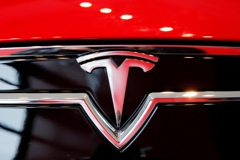 A Tesla logo on a Model S is photographed inside of a Tesla dealership in New York, U.S., April 29, 2016. REUTERS/Lucas Jackson//File Photo